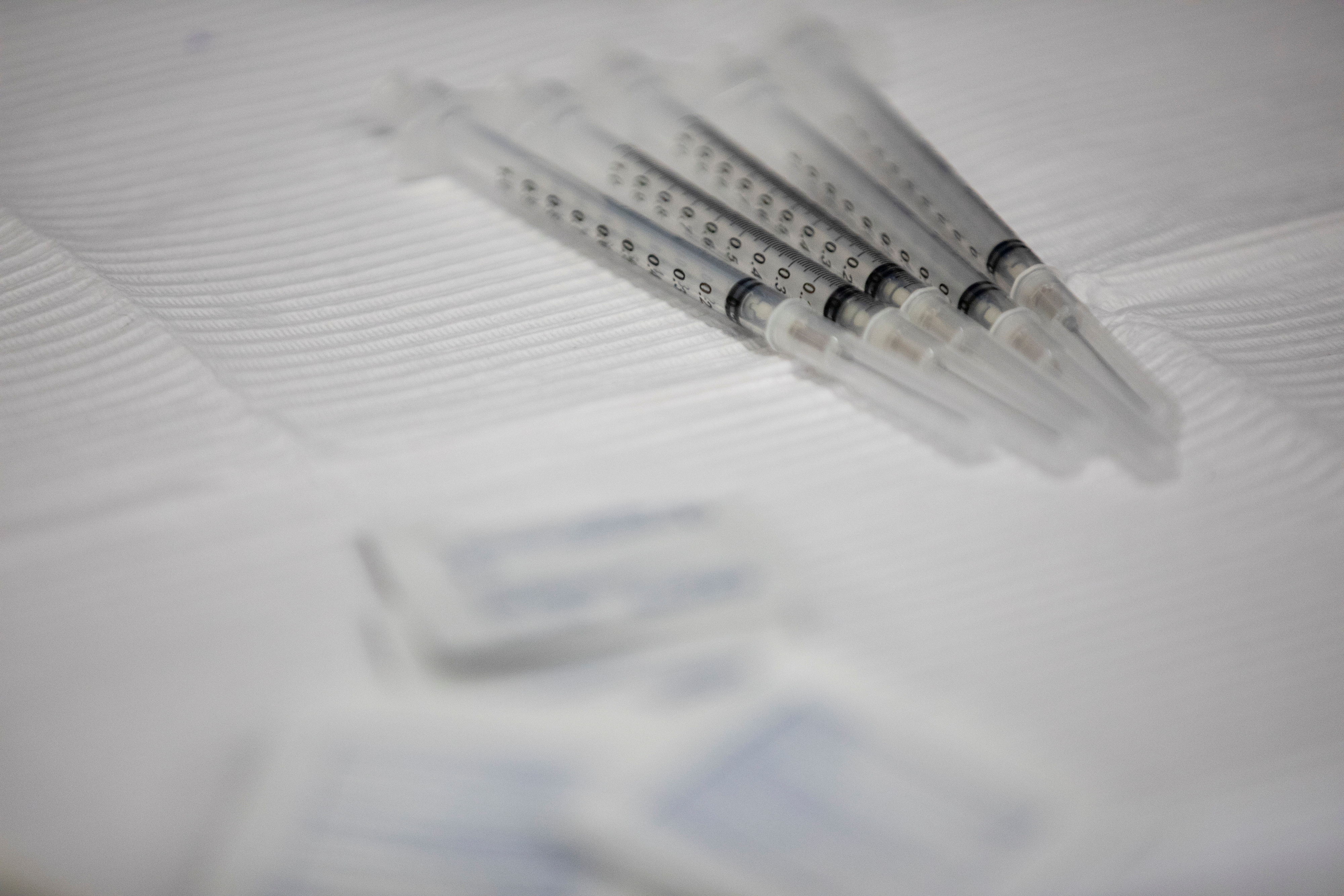 Syringes filled with the Pfizer-BioNTech vaccine sit on table during  vaccine clinic in Southfield, Michigan, U.S., September 29, 2021.  REUTERS/Emily Elconin