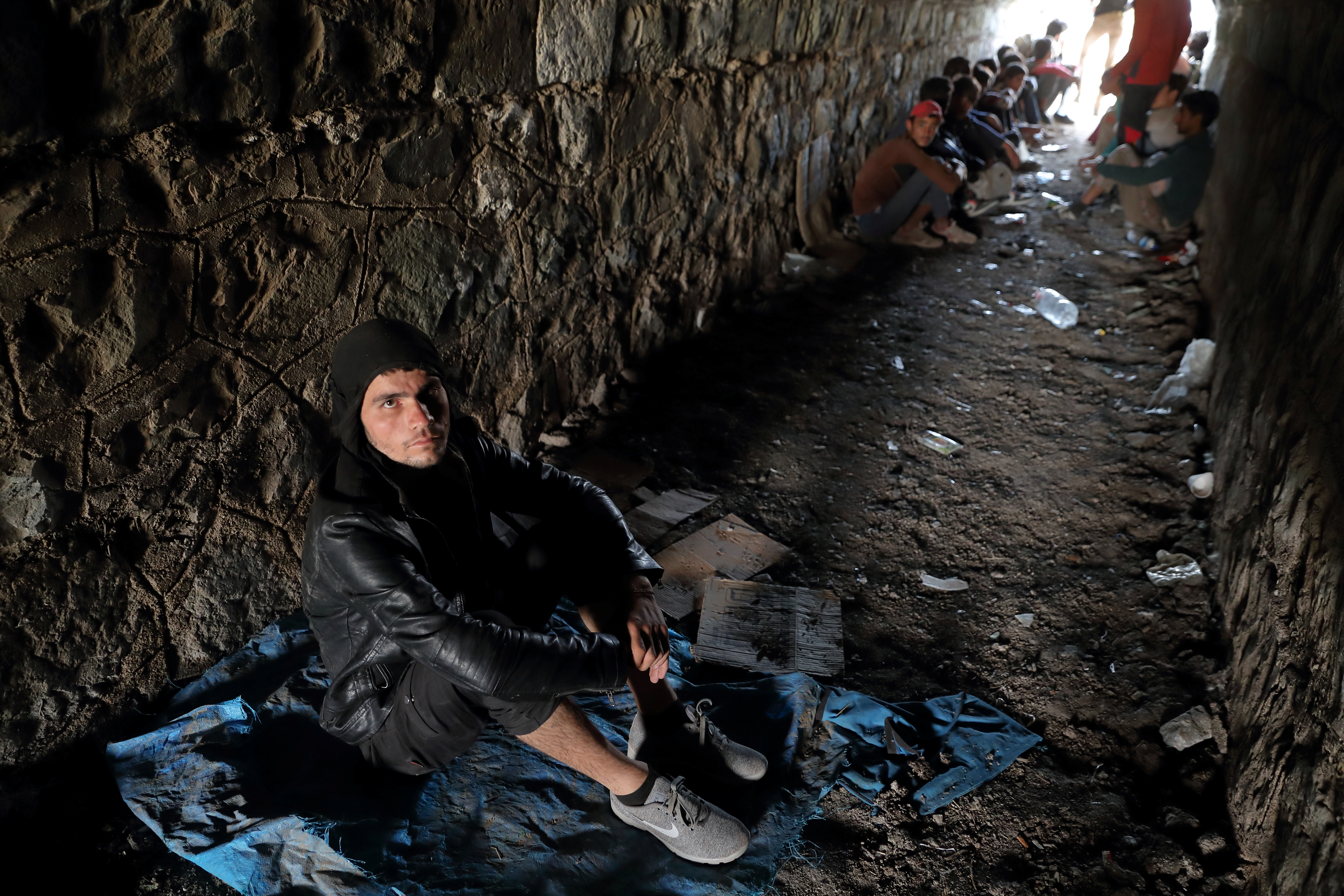 Afghan migrants hide from security forces in a tunnel under train tracks after crossing illegally into Turkey from Iran, near Tatvan in Bitlis province, Turkey August 23, 2021. Picture taken August 23, 2021. REUTERS/Murad Sezer