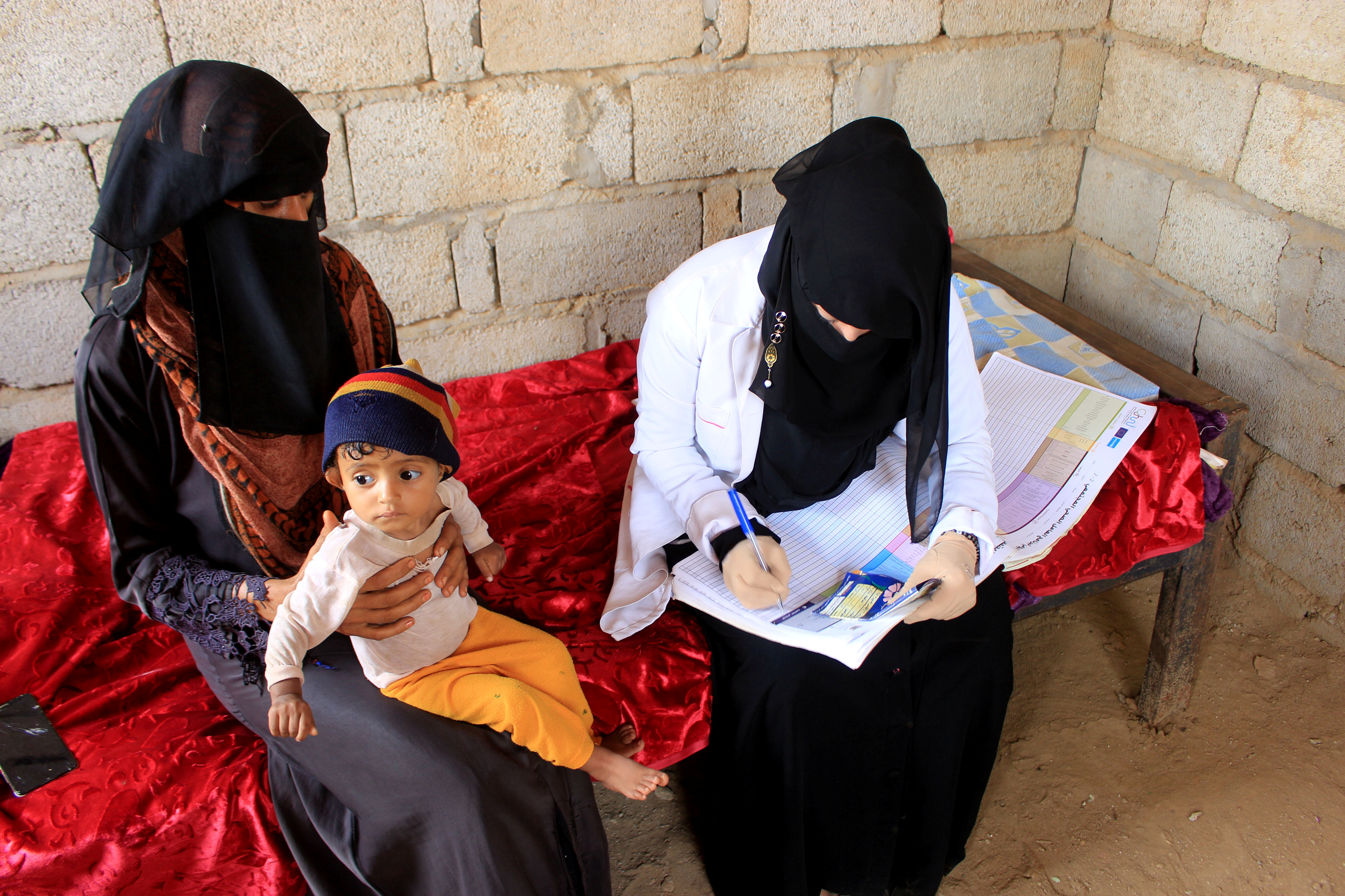 Volunteer health worker Ashwaq Muharram obtains the information about a boy as she assesses his nutritional status in Abs, Yemen August 31, 2021. REUTERS/Eissa Alragehi  NO RESALES. NO ARCHIVES.