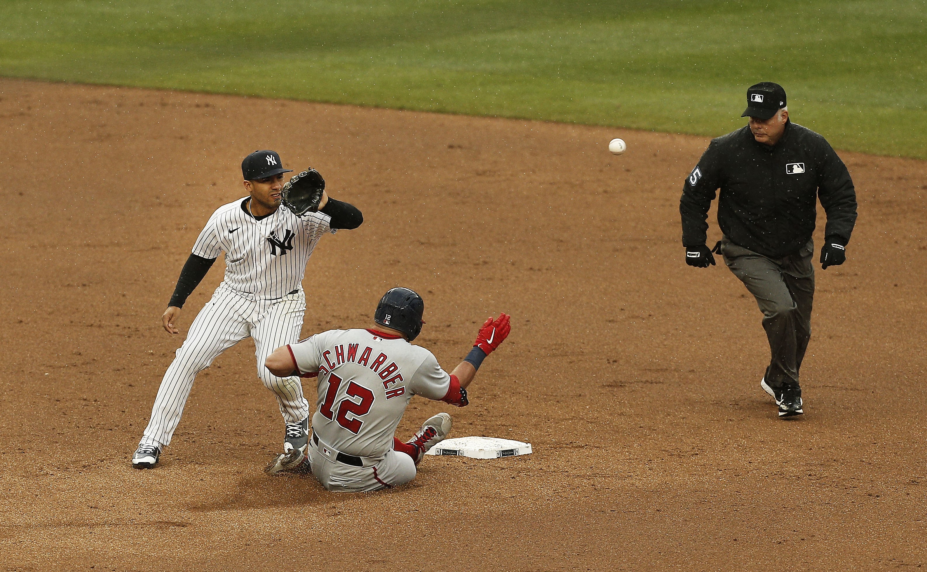 May 8, 2021; Bronx, New York, USA; Washington Nationals left fielder Kyle Schwarber (12) slides safely into second base after hitting a double against the New York Yankees during the sixth inning at Yankee Stadium. Mandatory Credit: Andy Marlin-USA TODAY Sports