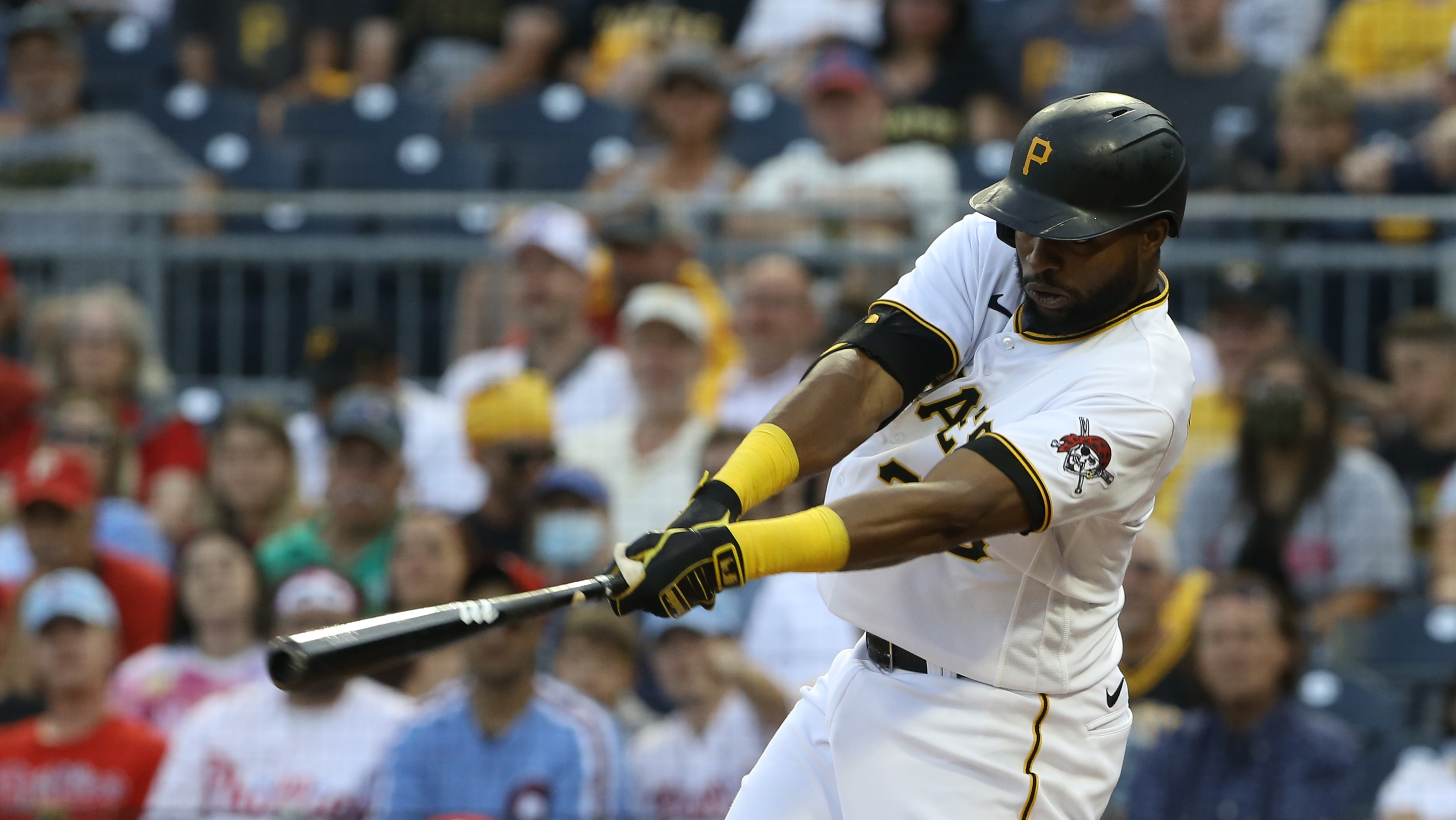 Jul 30, 2021; Pittsburgh, Pennsylvania, USA;  Pittsburgh Pirates right fielder Gregory Polanco (25) hits an RBI single against the Philadelphia Phillies during the first inning at PNC Park. Mandatory Credit: Charles LeClaire-USA TODAY Sports