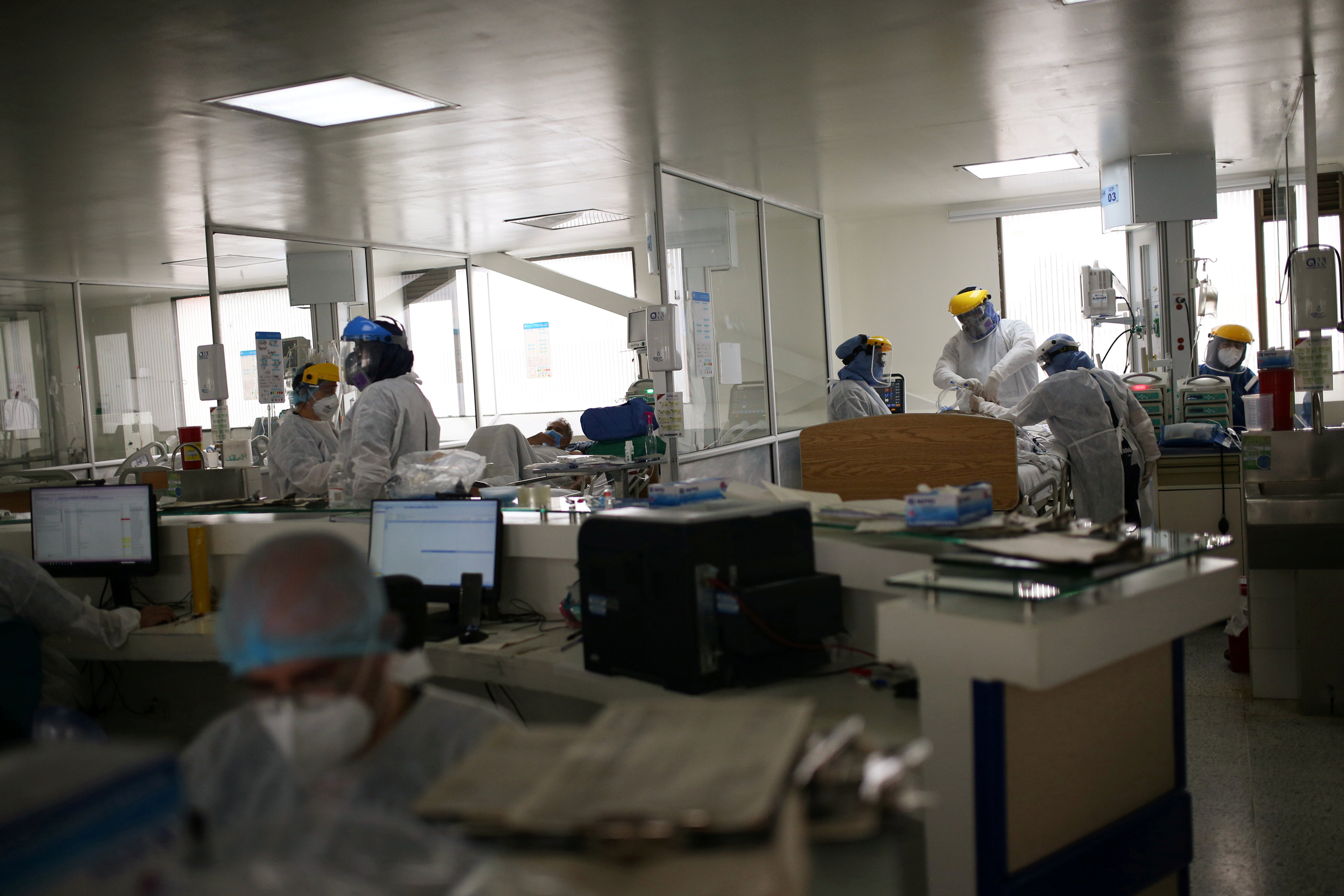 Doctors and nurses are seen inside the Intensive Care Unit (ICU) of the El Tunal hospital, where they treat patients suffering from the coronavirus disease (COVID-19), in Bogota, Colombia June 12, 2020. Picture taken June 12, 2020. REUTERS/Luisa Gonzalez