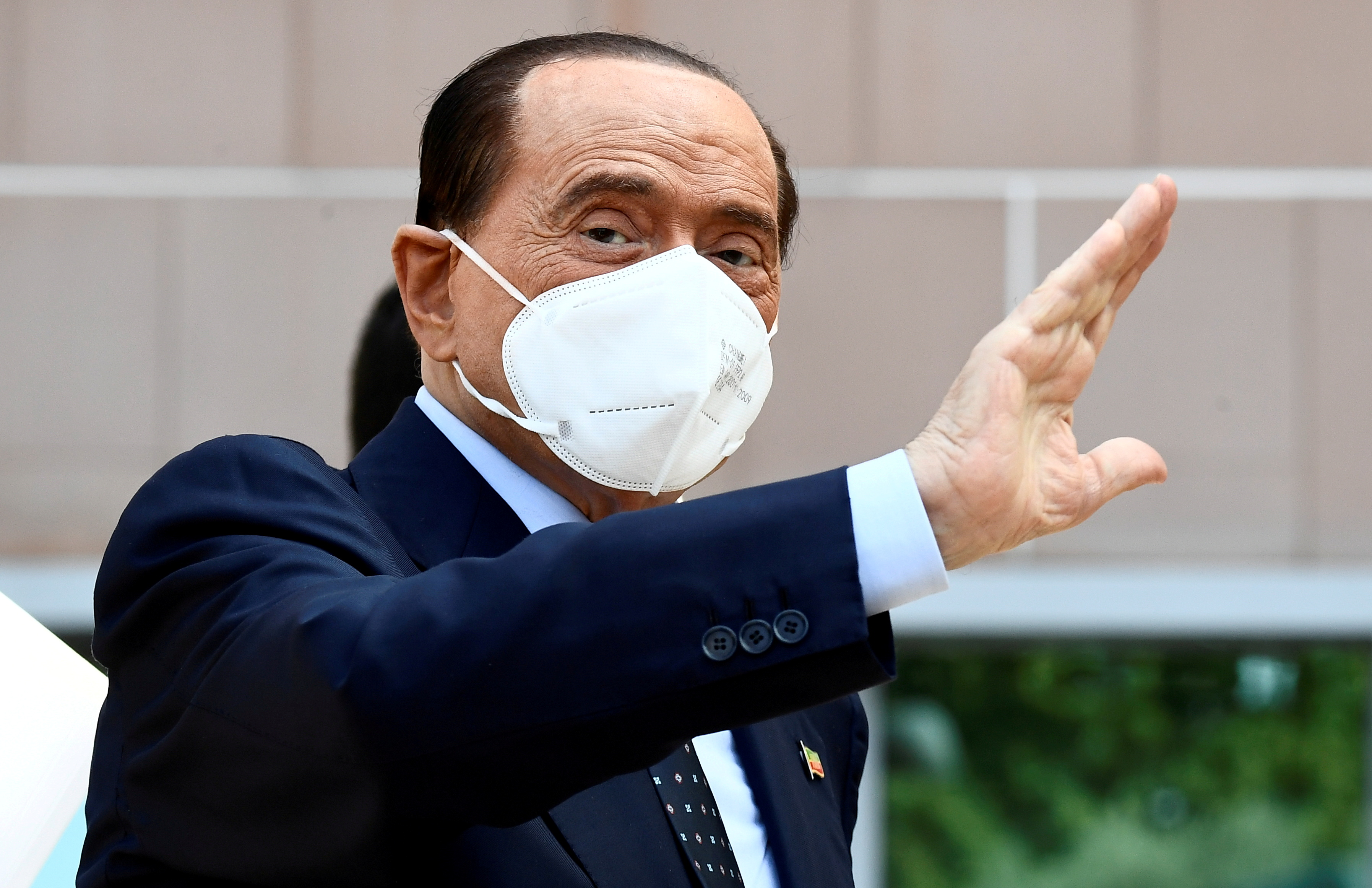 Former Italian Prime Minister Silvio Berlusconi gestures as he is discharged from Milan's San Raffaele hospital, where he was being treated after testing positive for the coronavirus disease (COVID-19) and diagnosed with mild pneumonia, in Milan, Italy, September 14, 2020. REUTERS/Flavio Lo Scalzo//File Photo