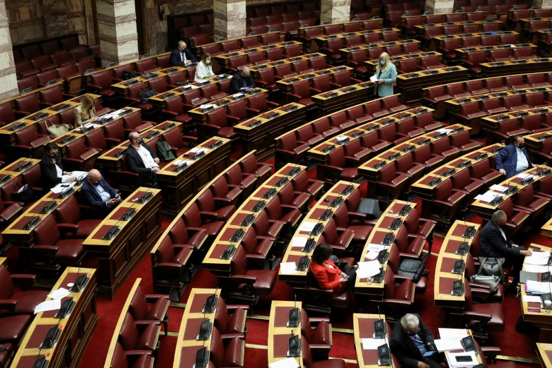 Greek lawmakers attend a parliamentary session ahead of a vote on a new labour bill, in Athens, Greece, June 16, 2021. REUTERS/Louiza Vradi