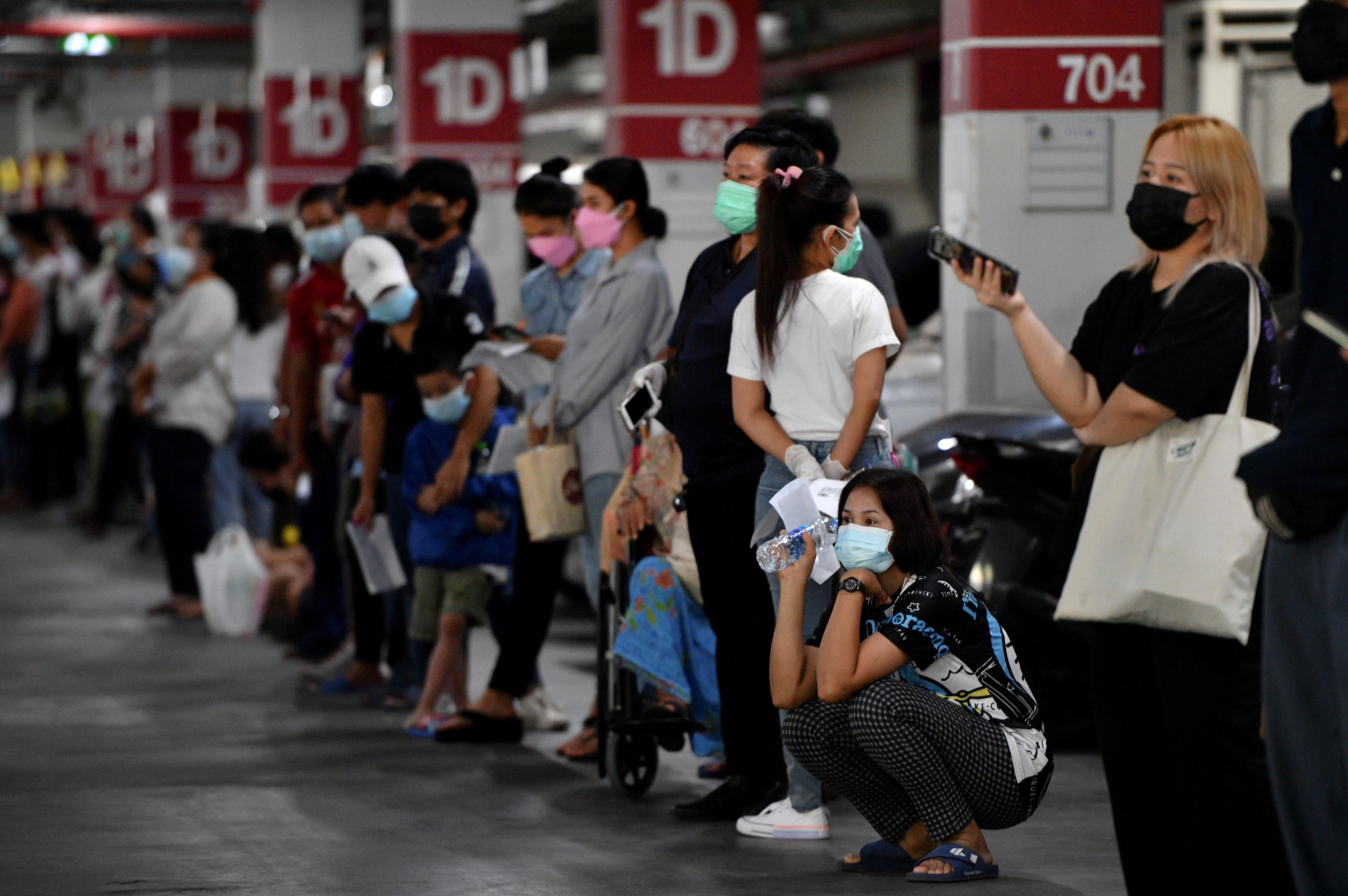 People queue for free coronavirus tests in Bangkok, Thailand, July 15, 2021. REUTERS/Chalinee Thirasupa/File Photo