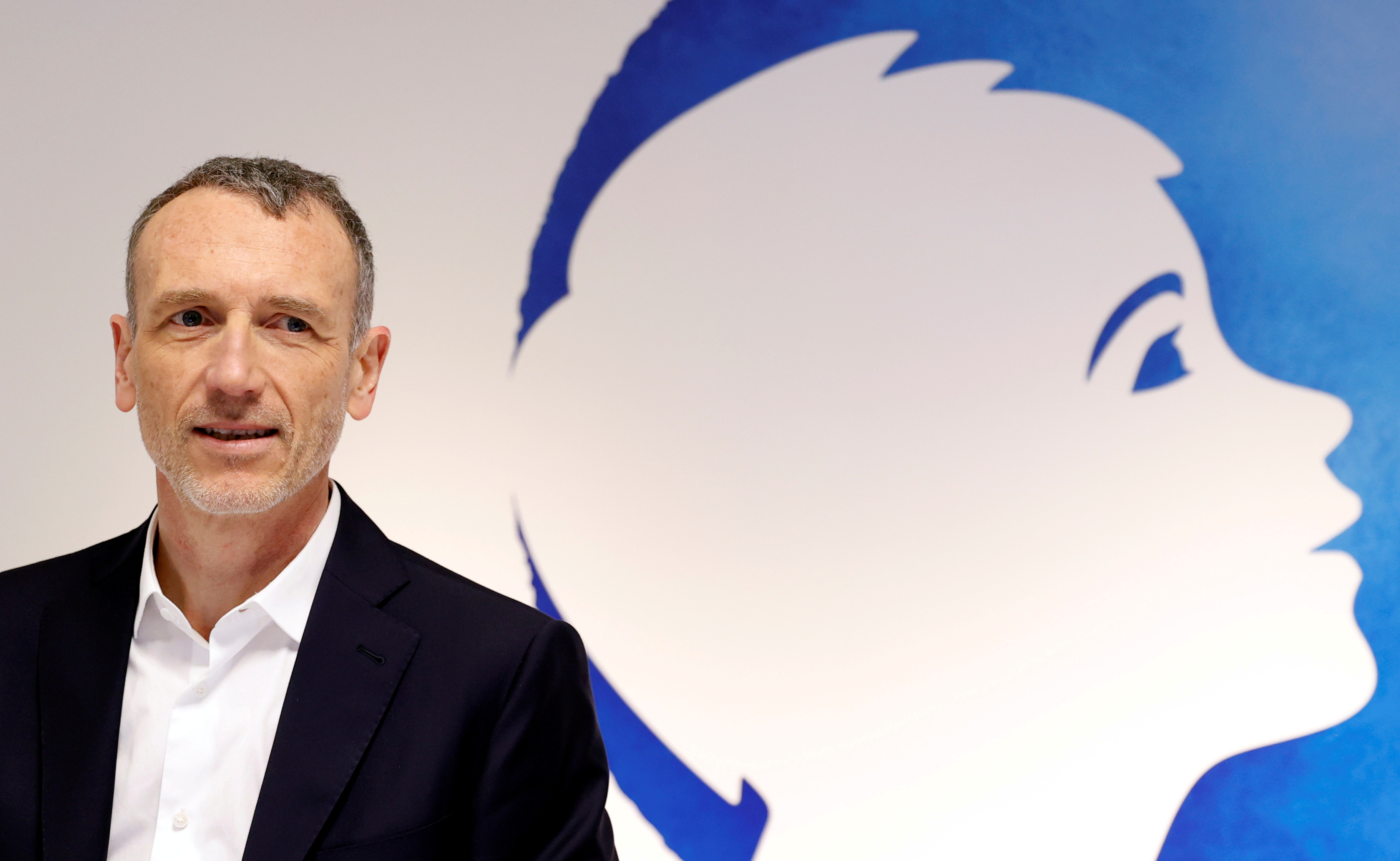 Emmanuel Faber, Chief Executive of French food group Danone, poses before a news conference to present the company