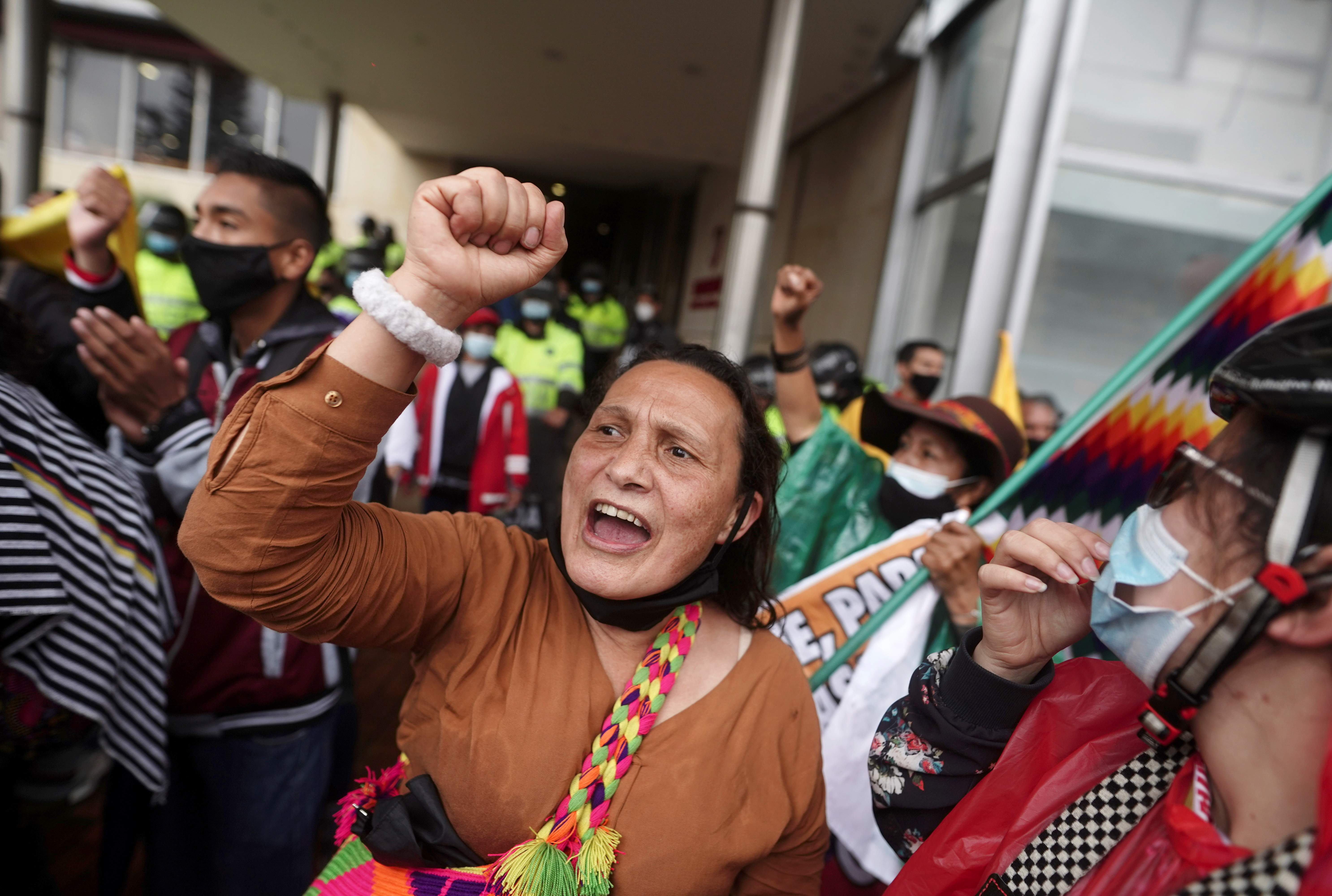 Demonstrators gather outside a local hotel where representatives of the Inter-American Commission on Human Rights (CIDH) and union leaders meet, in Bogota, Colombia June 9, 2021. REUTERS/Nathalia Angarita