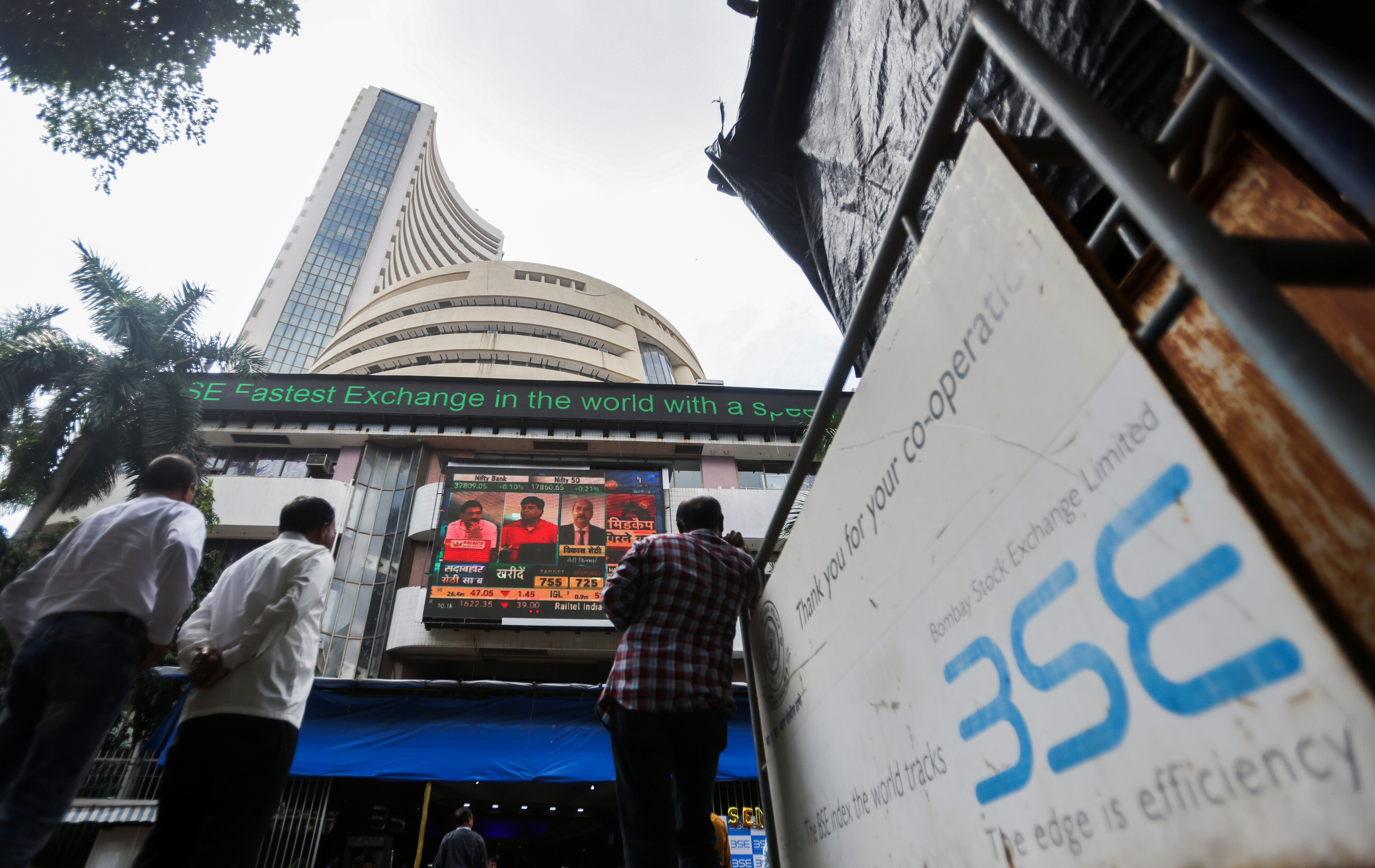 People stand outside the Bombay Stock Exchange (BSE), after Sensex surpassed the 60,000 level for the first time, in Mumbai, India, September 24, 2021. REUTERS/Francis Mascarenhas