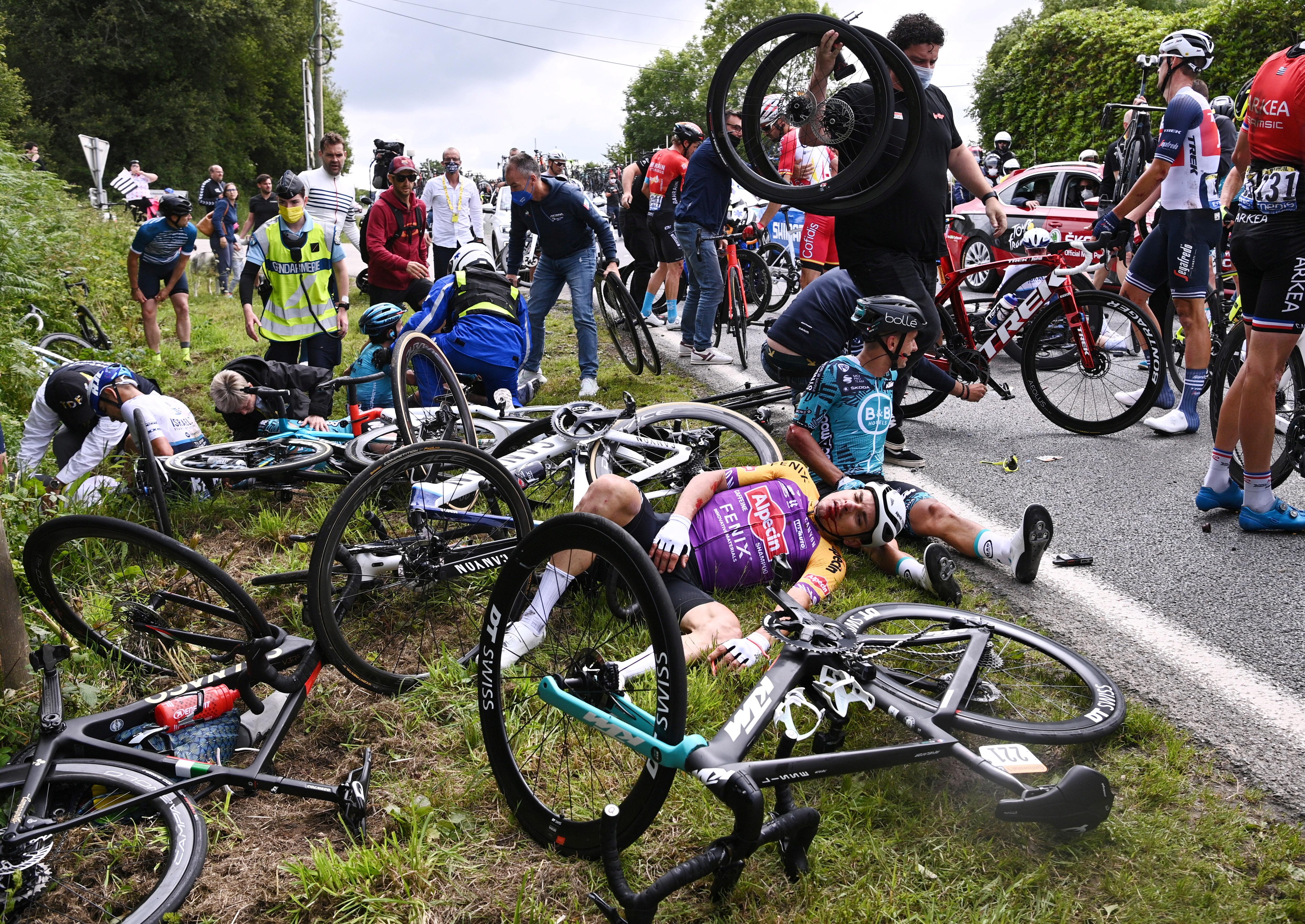 Cycling - Tour de France - Stage 1 - Brest to Landerneau - France - June 26, 2021 B&B Hotels p/b KTM rider Bryan Coquard of France reacts after a crash REUTERS/Anne-Christine Poujoulat