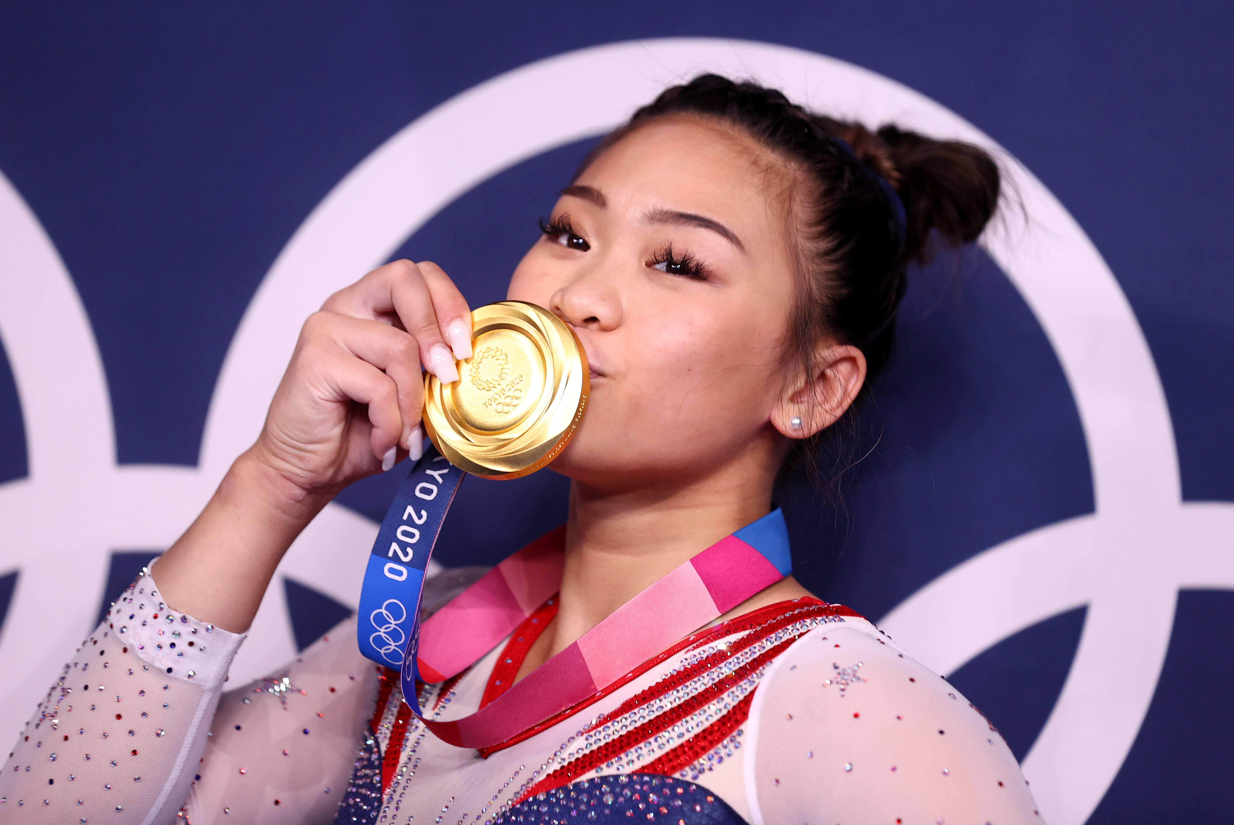 Tokyo 2020 Olympics - Gymnastics - Artistic - Women's Individual All-Around - Medal Ceremony - Ariake Gymnastics Centre, Tokyo, Japan - July 29, 2021. Gold medallist Sunisa Lee of the United States kisses her medal in front of the olympic rings REUTERS/Lindsey Wasson