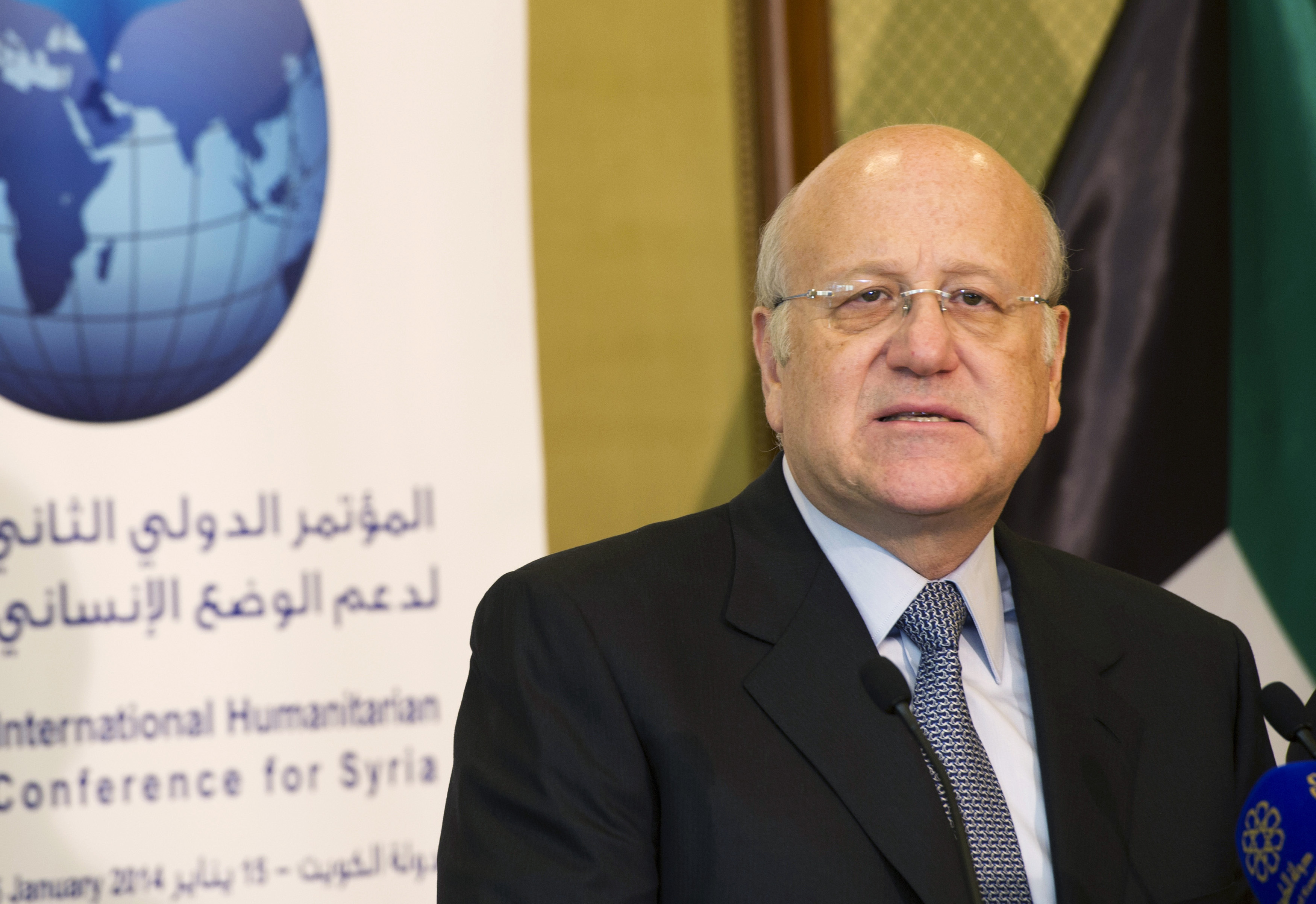 Najib Mikati attends a news conference at the opening session of the Syrian Donors Conference at Bayan Palace Liberation Hall in Kuwait City January 15, 2014. REUTERS/Stephanie McGehee/Files