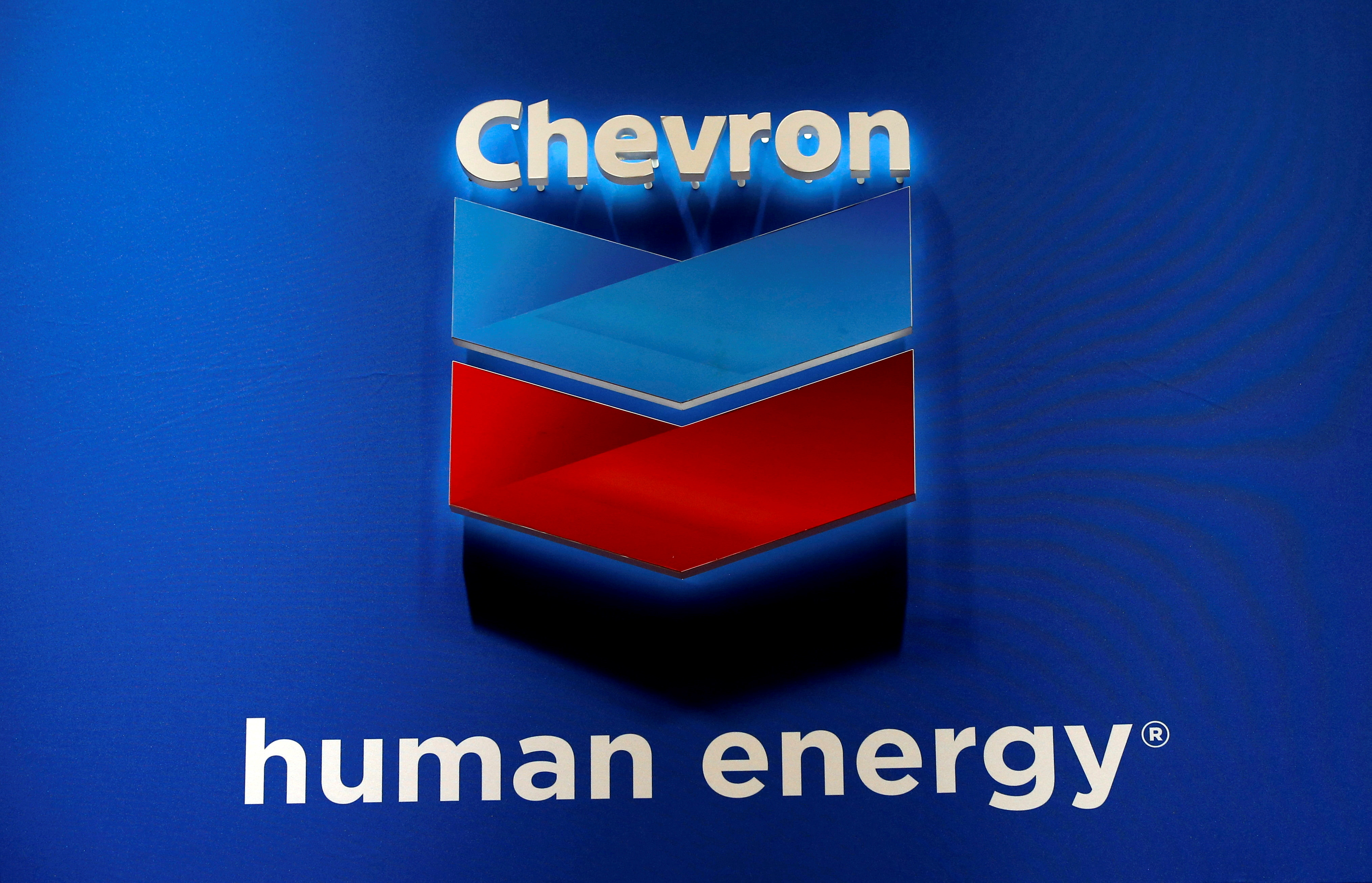 The logo of Chevron Corp is seen in its booth at Gastech, the world's biggest expo for the gas industry, in Chiba, Japan April 4, 2017.    REUTERS/Toru Hanai/File Photo