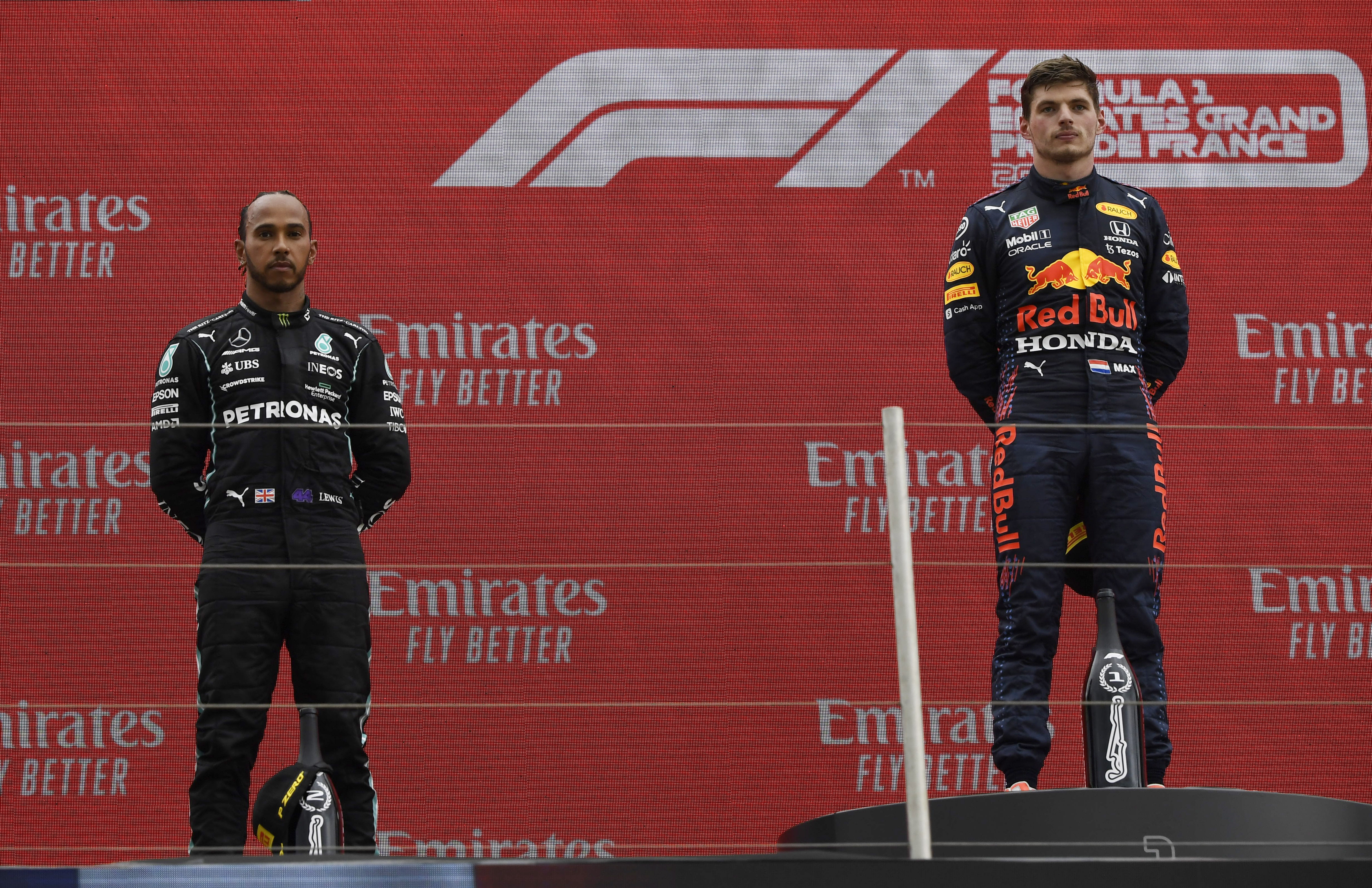 Formula One F1 - French Grand Prix - Circuit Paul Ricard, Le Castellet, France - June 20, 2021 Red Bull's Max Verstappen celebrates on the podium after winning the race alongside second placed Mercedes' Lewis Hamilton Pool via REUTERS/Nicolas Tucat