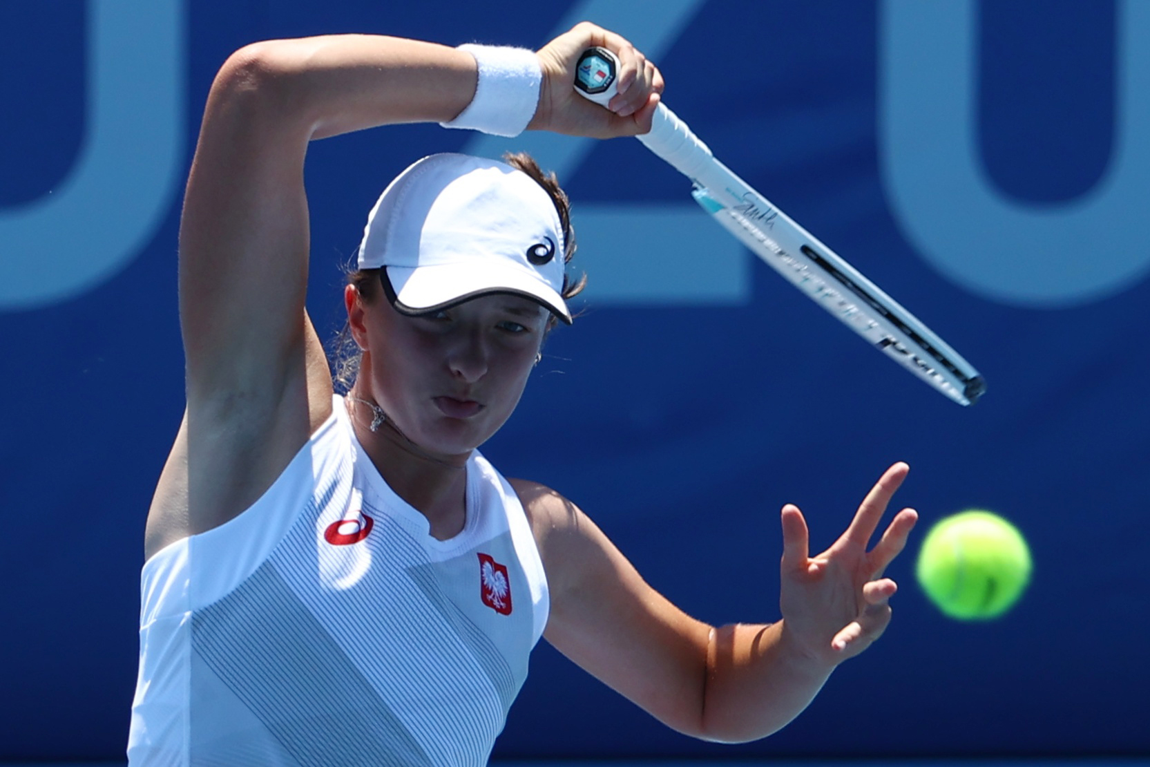 Tokyo 2020 Olympics - Tennis - Women's Singles - Round 1 - Ariake Tennis Park - Tokyo, Japan - July 24, 2021. Iga Swiatek of Poland in action during her first round match against Mona Barthel of Germany REUTERS/Mike Segar