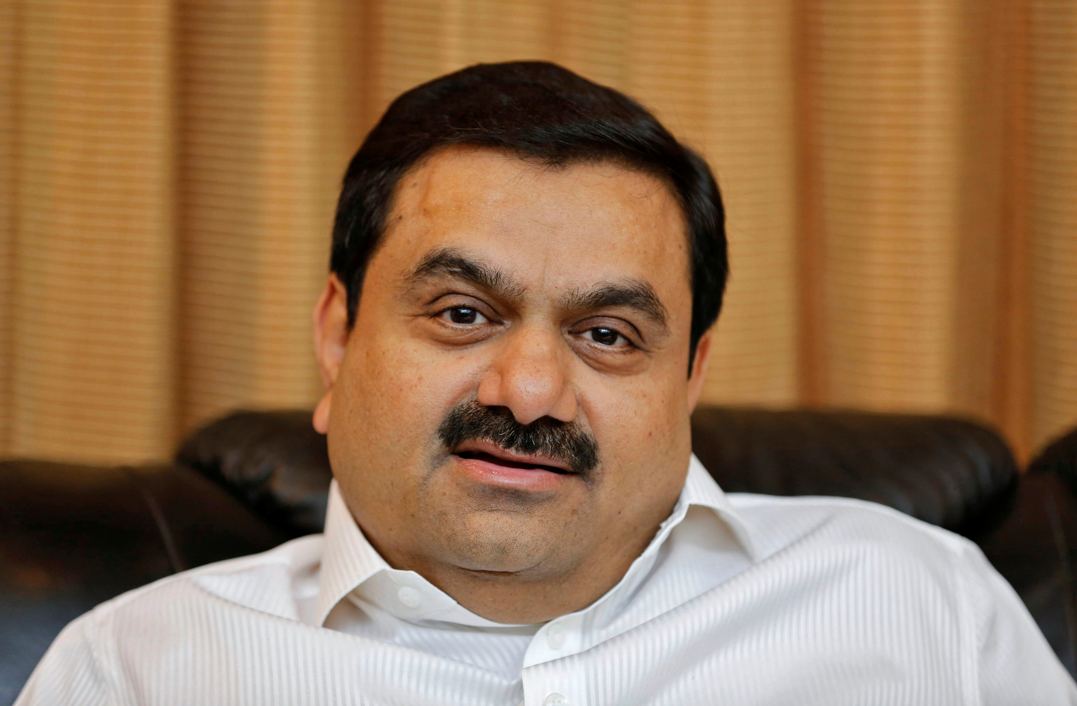Indian billionaire Gautam Adani speaks during an interview with Reuters at his office in Ahmedabad, India, April 2, 2014. REUTERS/Amit Dave/File Photo