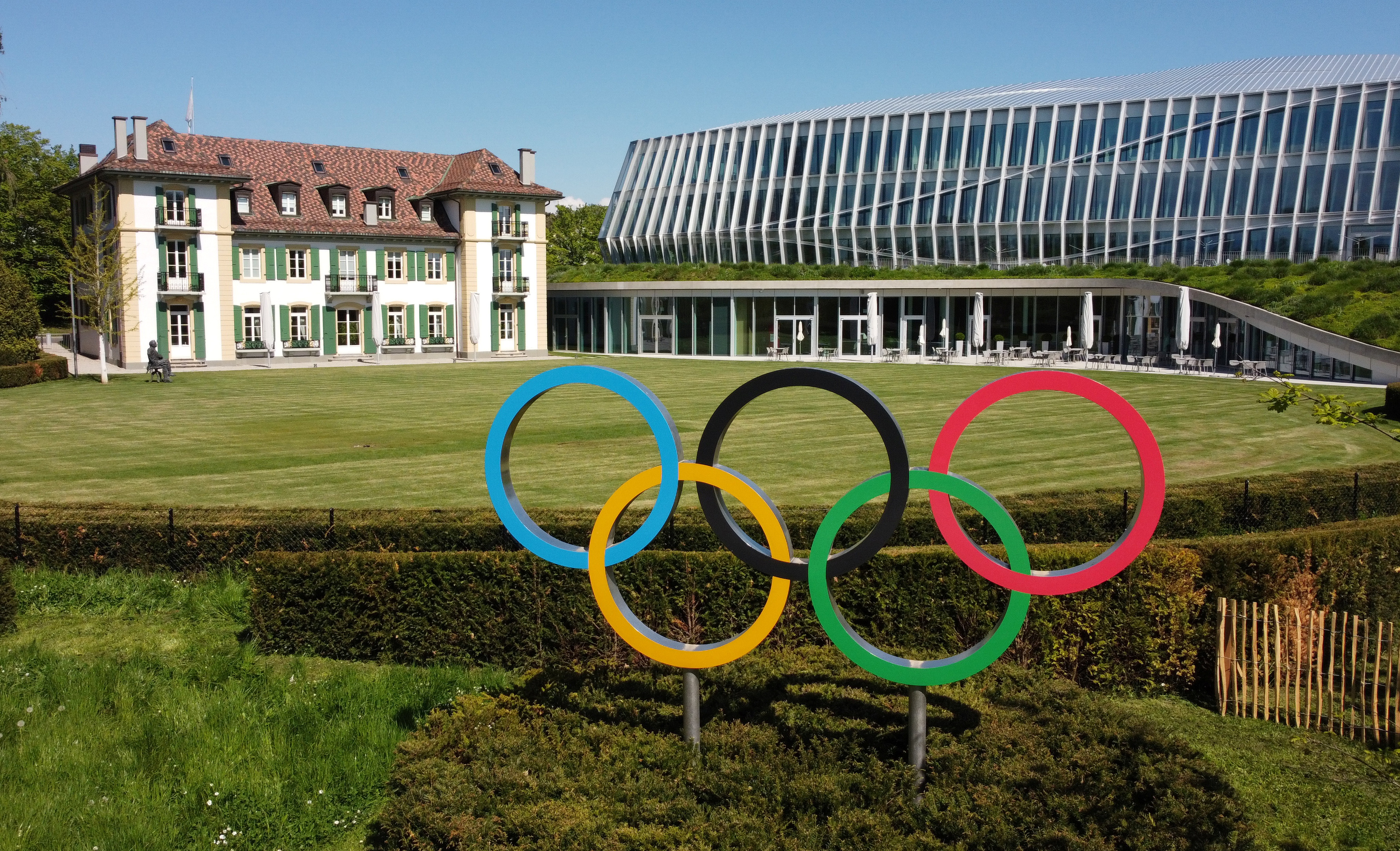 The Olympic rings are pictured in front of the International Olympic Committee (IOC) headquarters in Lausanne, Switzerland, May 3, 2021. Picture taken with a drone. REUTERS/Denis Balibouse