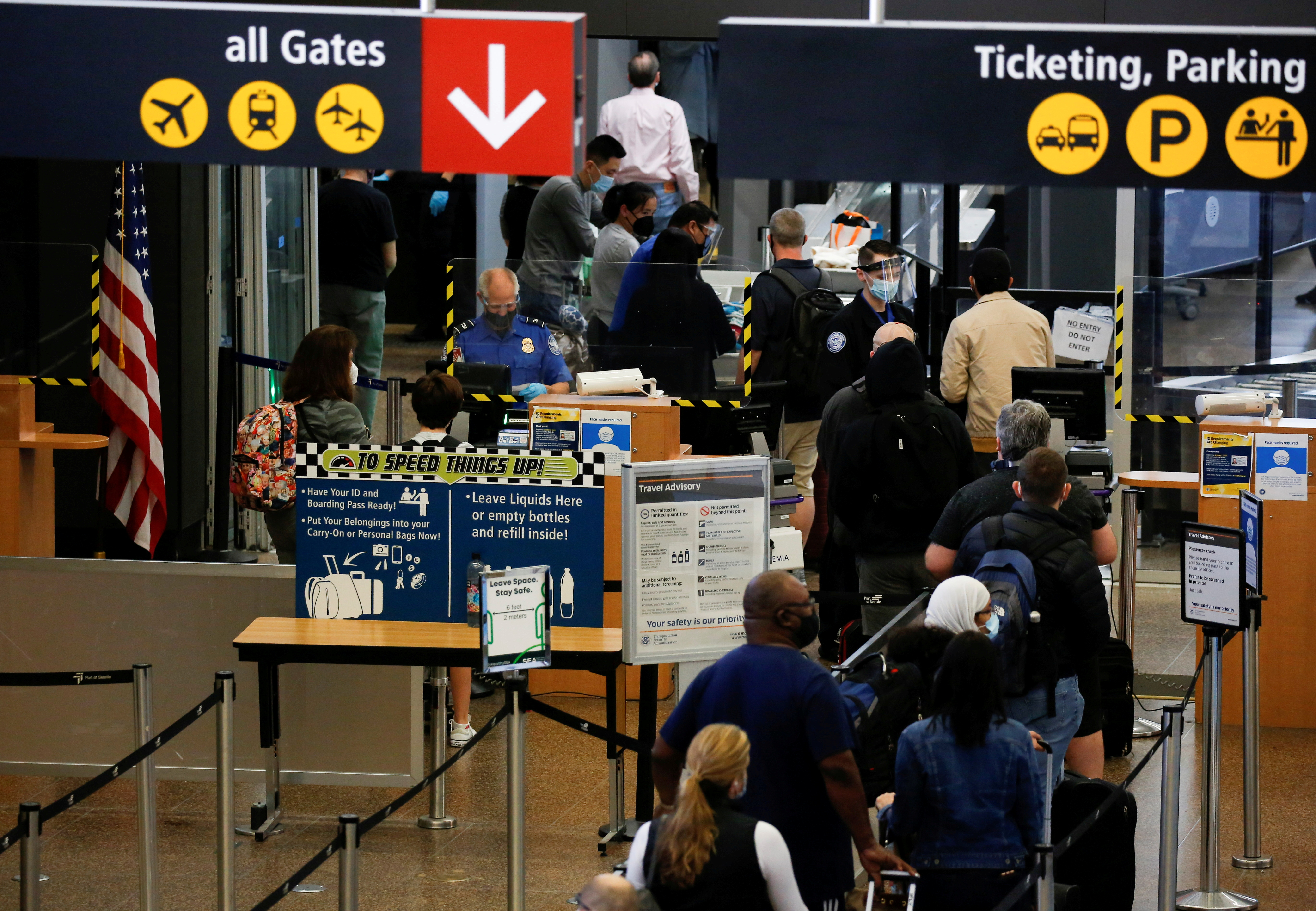 Travelers queue in a security line limited to every other lane for social distancing at Seattle-Tacoma International Airport in SeaTac, Washington, U.S. April 12, 2021.  REUTERS/Lindsey Wasson/File Photo