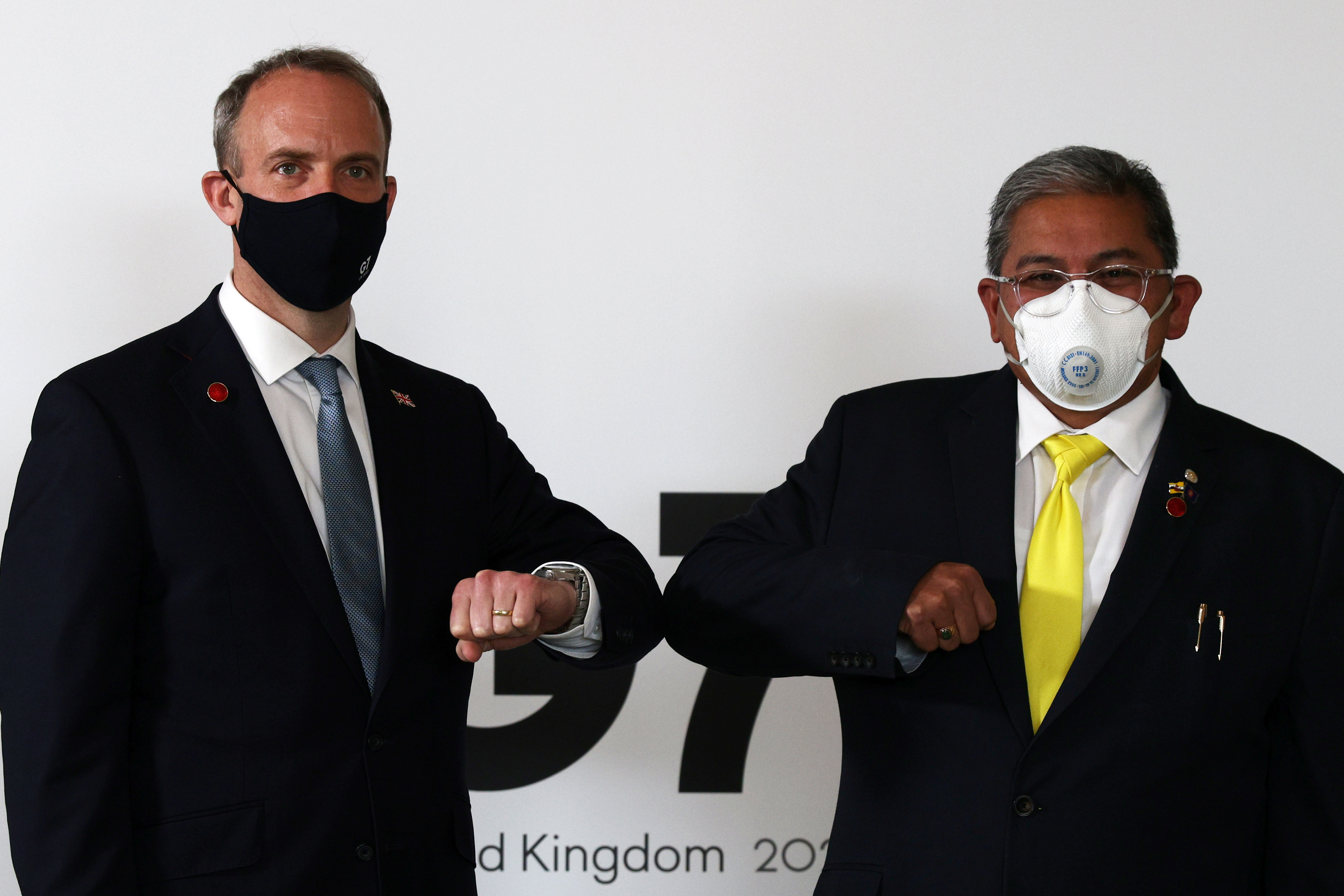 Britain's Foreign Secretary Dominic Raab poses with Brunei Second Minister of Foreign affairs Erywan Yusof during a bilateral meeting at the G7 foreign ministers meeting in London, Britain May 5, 2021. Adrian Dennis/Pool via REUTERS
