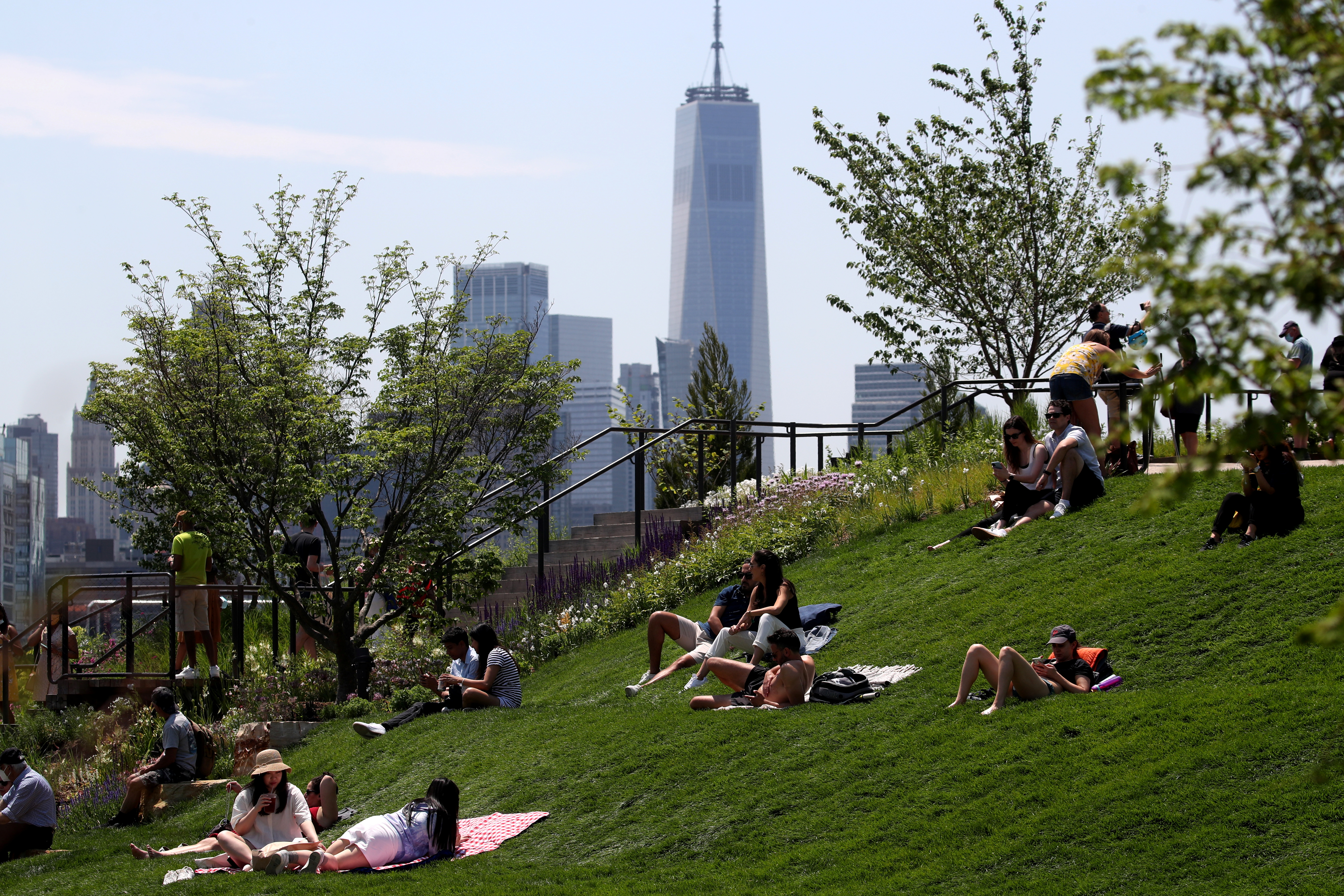 People visit Little Island Park, almost three acres of new public park space which sits on stilts over the Hudson River and the remnants of Pier 54 in the larger Hudson River Park, on Manhattan's West Side, during the park's opening day in New York City, New York, U.S., May 21, 2021. REUTERS/Mike Segar