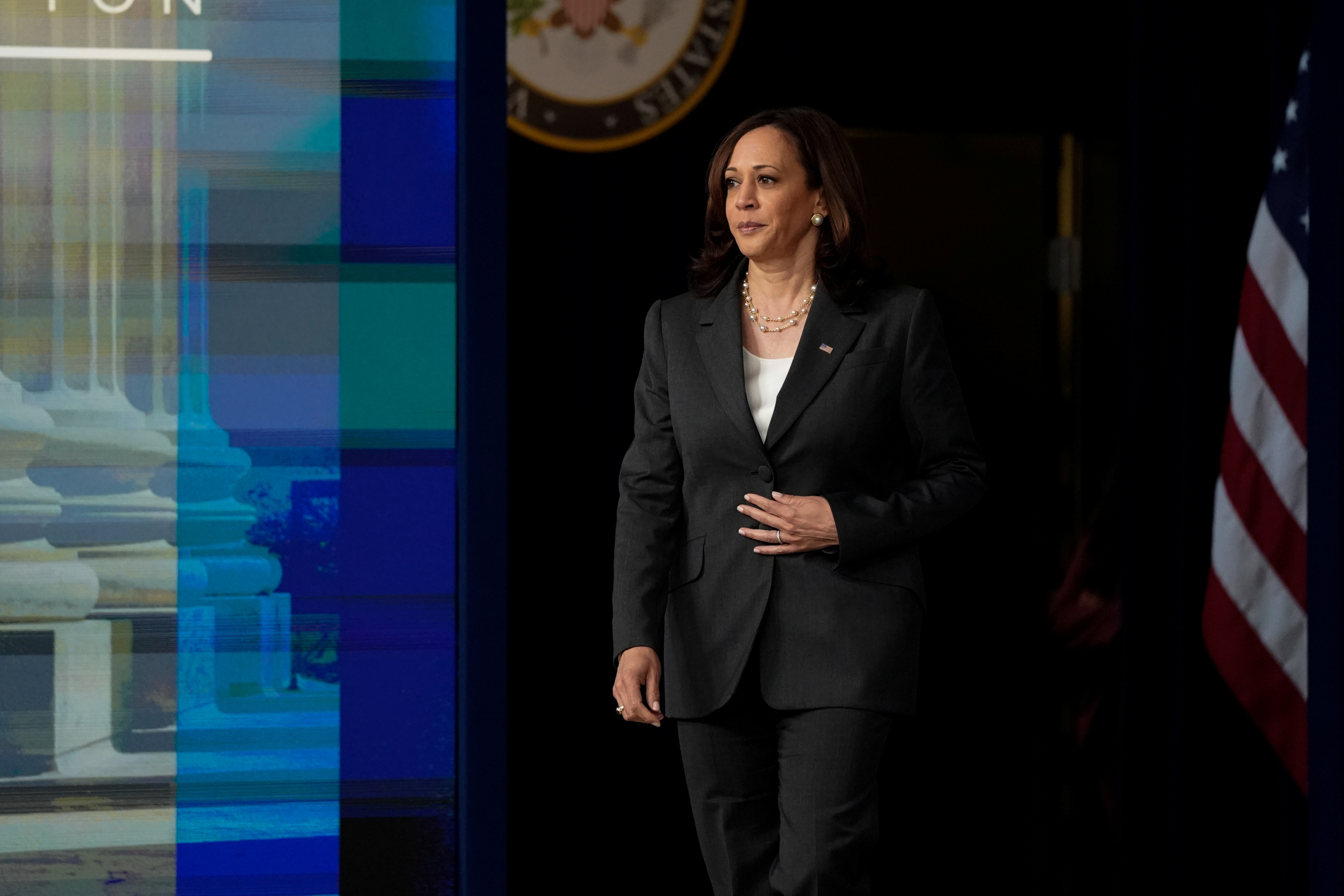 U.S. Vice President Kamala Harris walks on stage to deliver virtual remarks to the National Bar Association in the Eisenhower Executive Office Building's South Court Auditorium at the White House in Washington, U.S., July 27, 2021. REUTERS/Elizabeth Frantz/Pool/Files