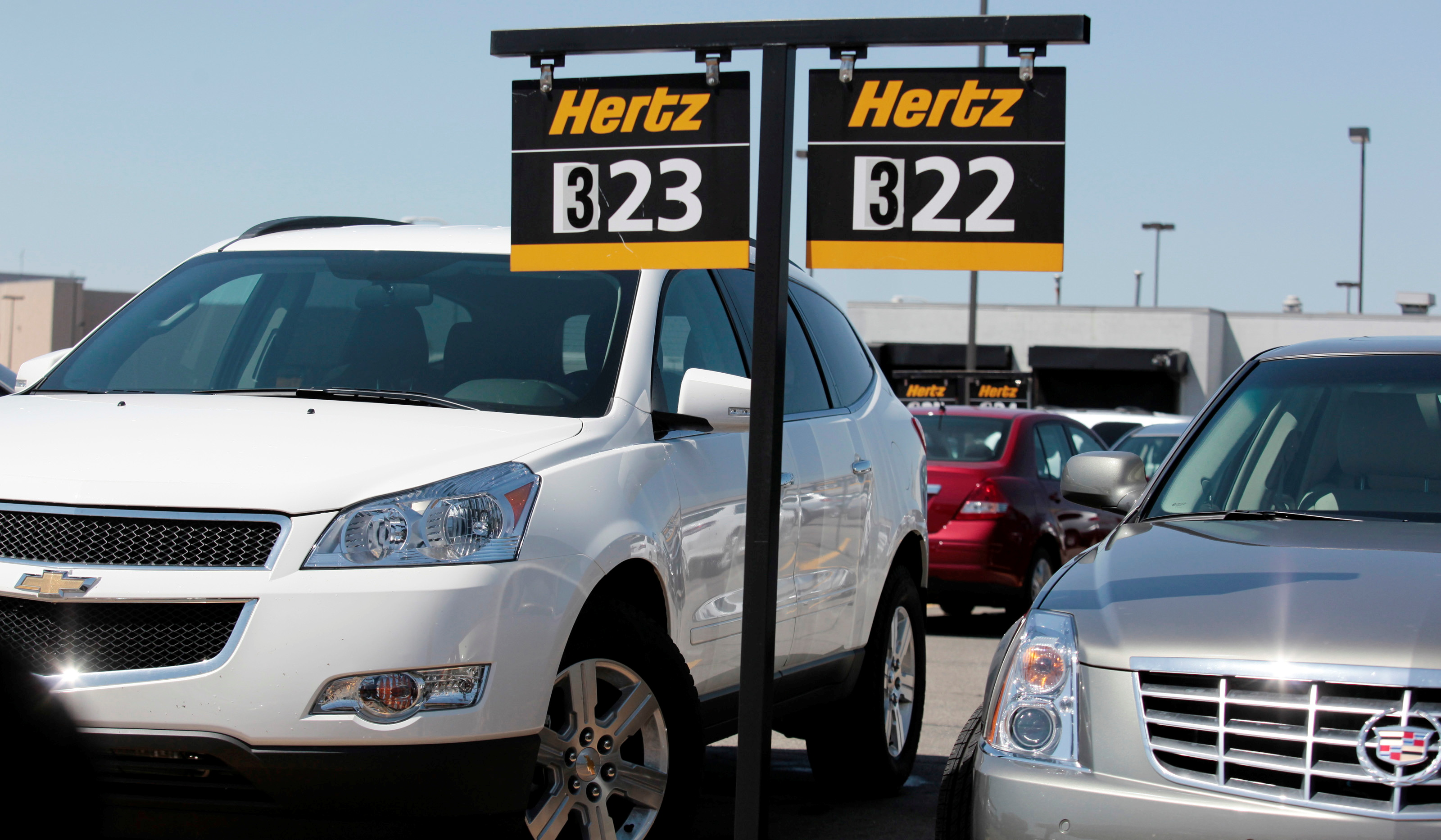 Hertz rental cars are parked in a rental lot near Detroit Metropolitan airport in Romulus, Michigan May 9, 2011. REUTERS/Rebecca Cook