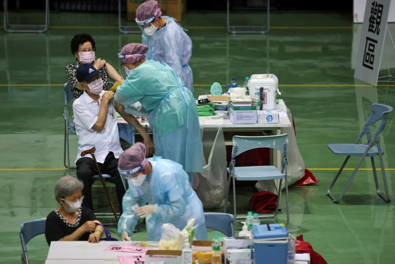People receive a vaccine against the coronavirus disease (COVID-19) during a vaccination session for elderly people over 85 years old, at a sports stadium in New Taipei City, Taiwan June 15, 2021. REUTERS/Ann Wang
