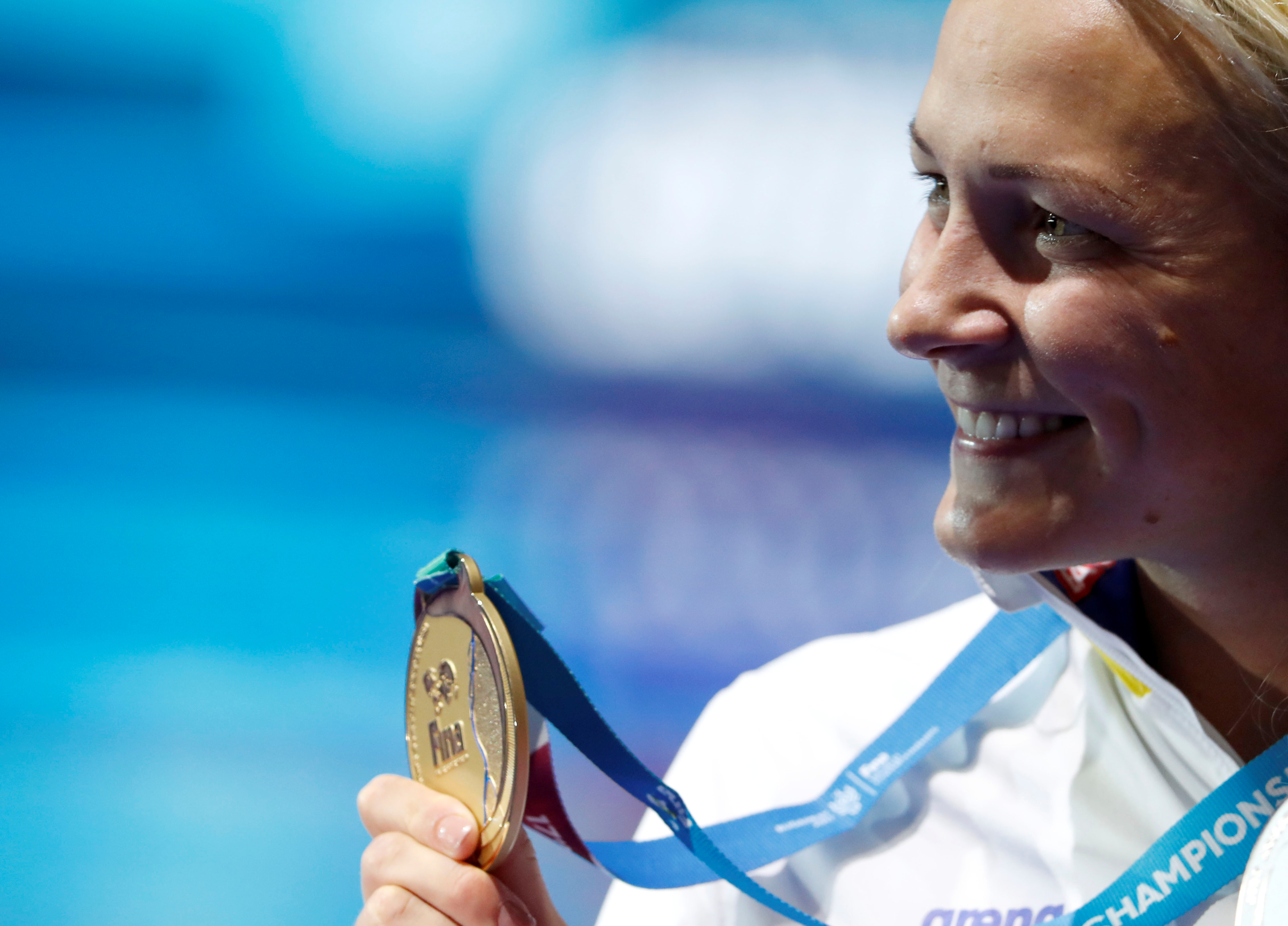 Swimming – 17th FINA World Aquatics Championships – Women's Freestyle 50m Medal Ceremony – Budapest, Hungary – July 230, 2017 – Sarah Sjostrom of Sweden (gold) poses with the medal. REUTERS/Bernadett Szabo/File Photo