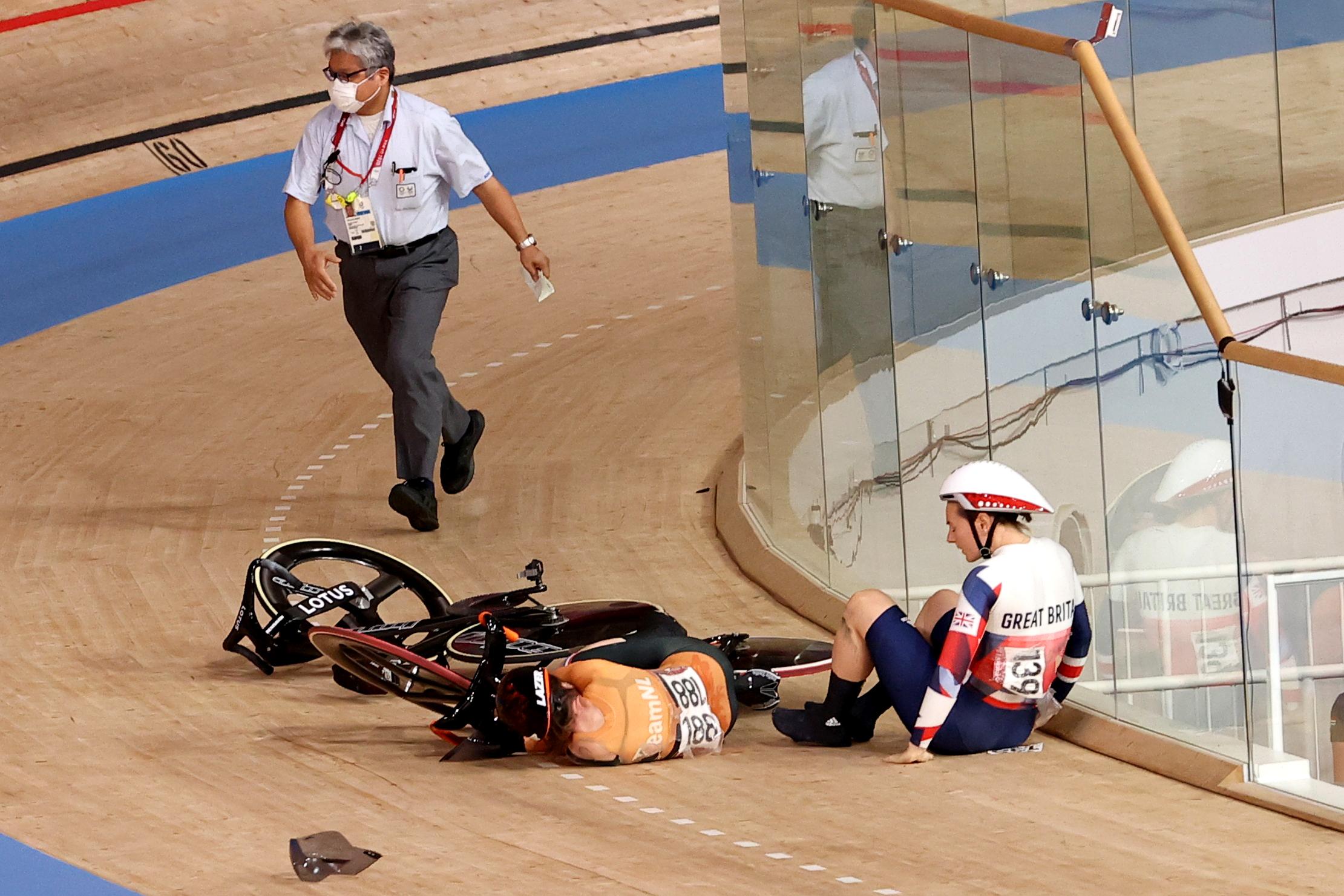 Tokyo 2020 Olympics - Cycling - Track - Women's Keirin - Quarterfinal - Izu Velodrome, Shizuoka, Japan - August 5, 2021.  Laurine van Riessen of the Netherlands and Katy Marchant of Britain crash. REUTERS/Kacper Pempel