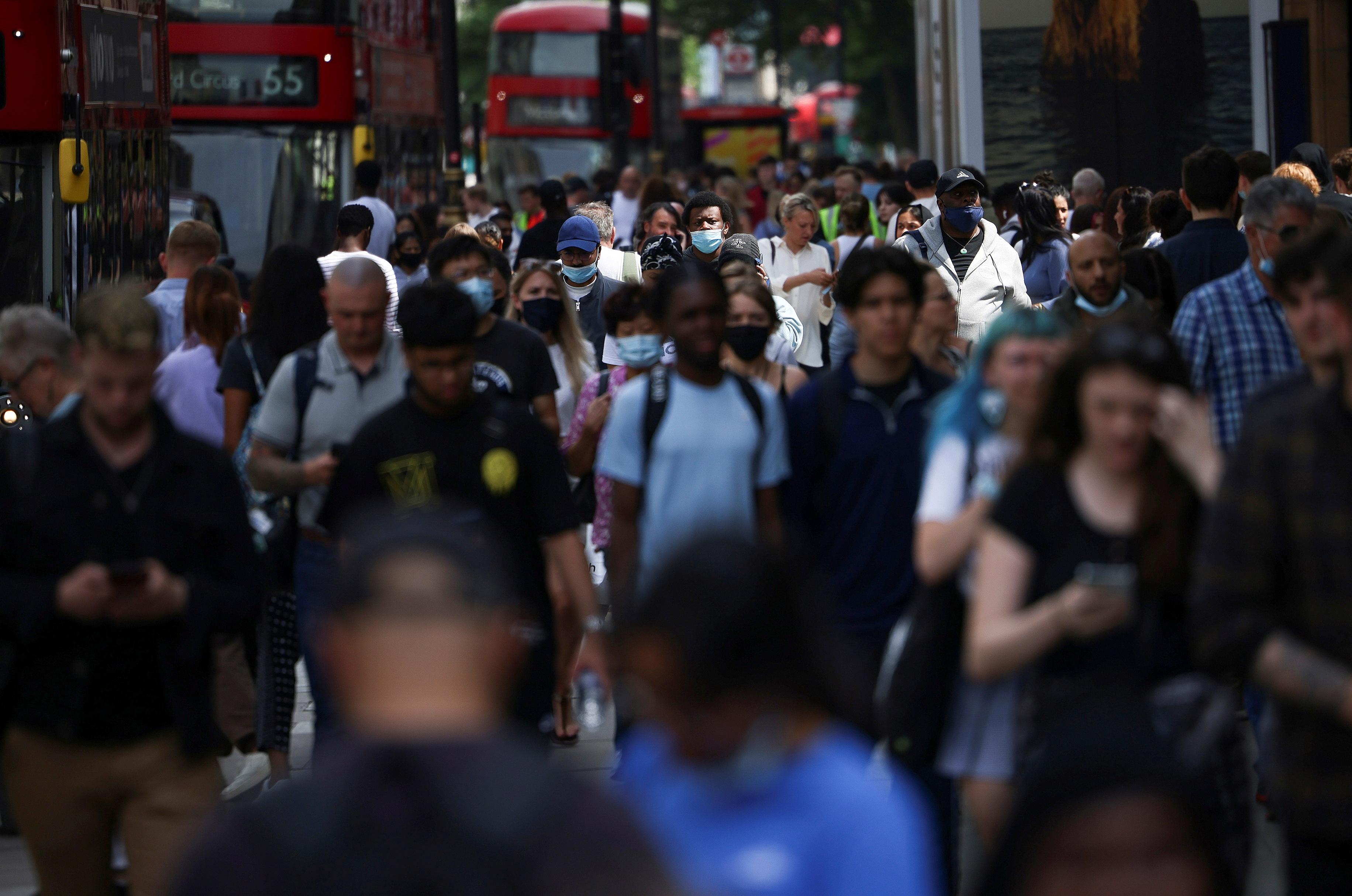 People walk along Oxford Street, amid the coronavirus disease (COVID-19) outbreak, in London, Britain, July 26, 2021. REUTERS/Henry Nicholls
