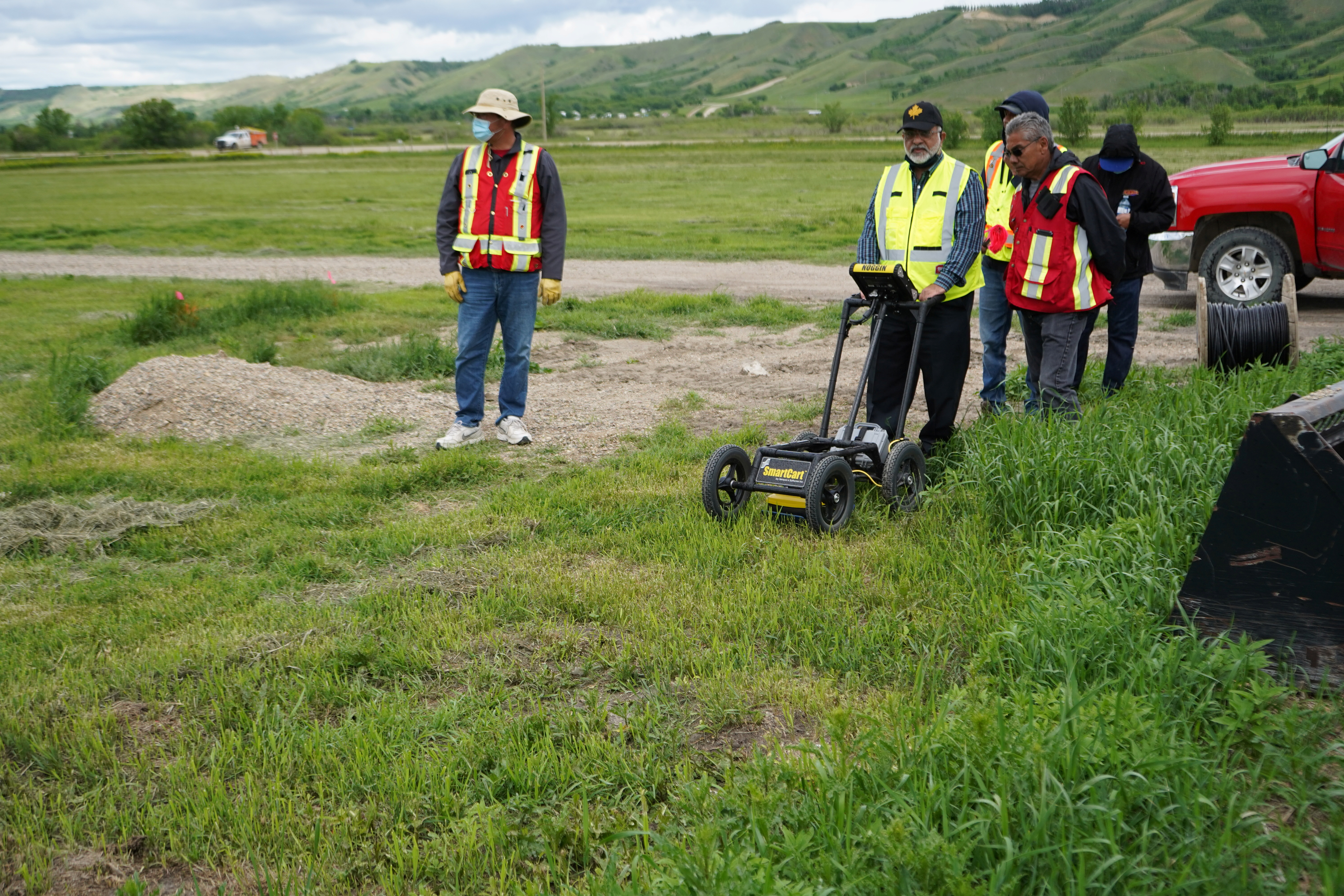 A crew performs a ground-penetrating radar search of a field, where the Cowessess First Nation said they had found 751 unmarked graves, near the former Marieval Indian Residential School in Grayson, Saskatchewan, Canada June 18, 2021.  Federation of Sovereign Indigenous Nations/Handout via REUTERS.