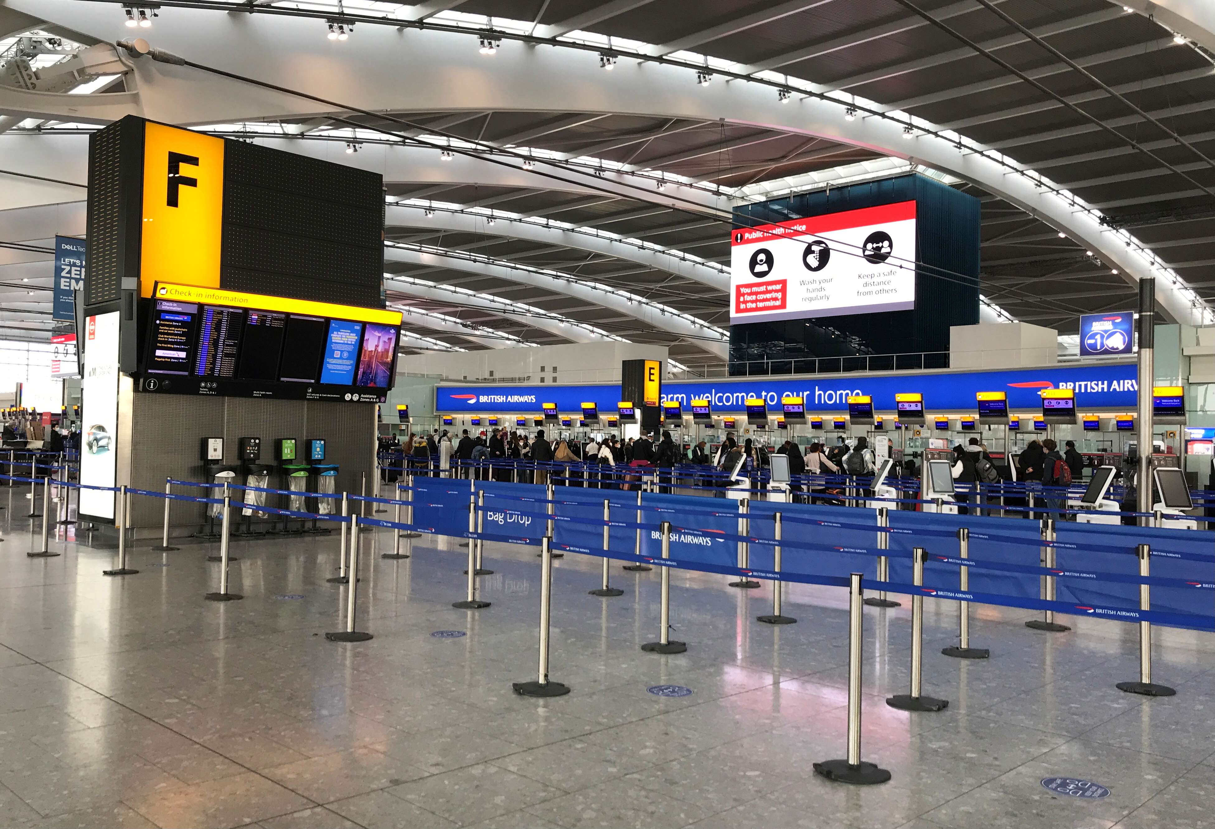 FIE PHOTO: Passengers are seen at BA check-in desks at Heathrow Airport, following the outbreak of the coronavirus disease (COVID-19), London, Britain January 15, 2021. REUTERS/Matthew Childs