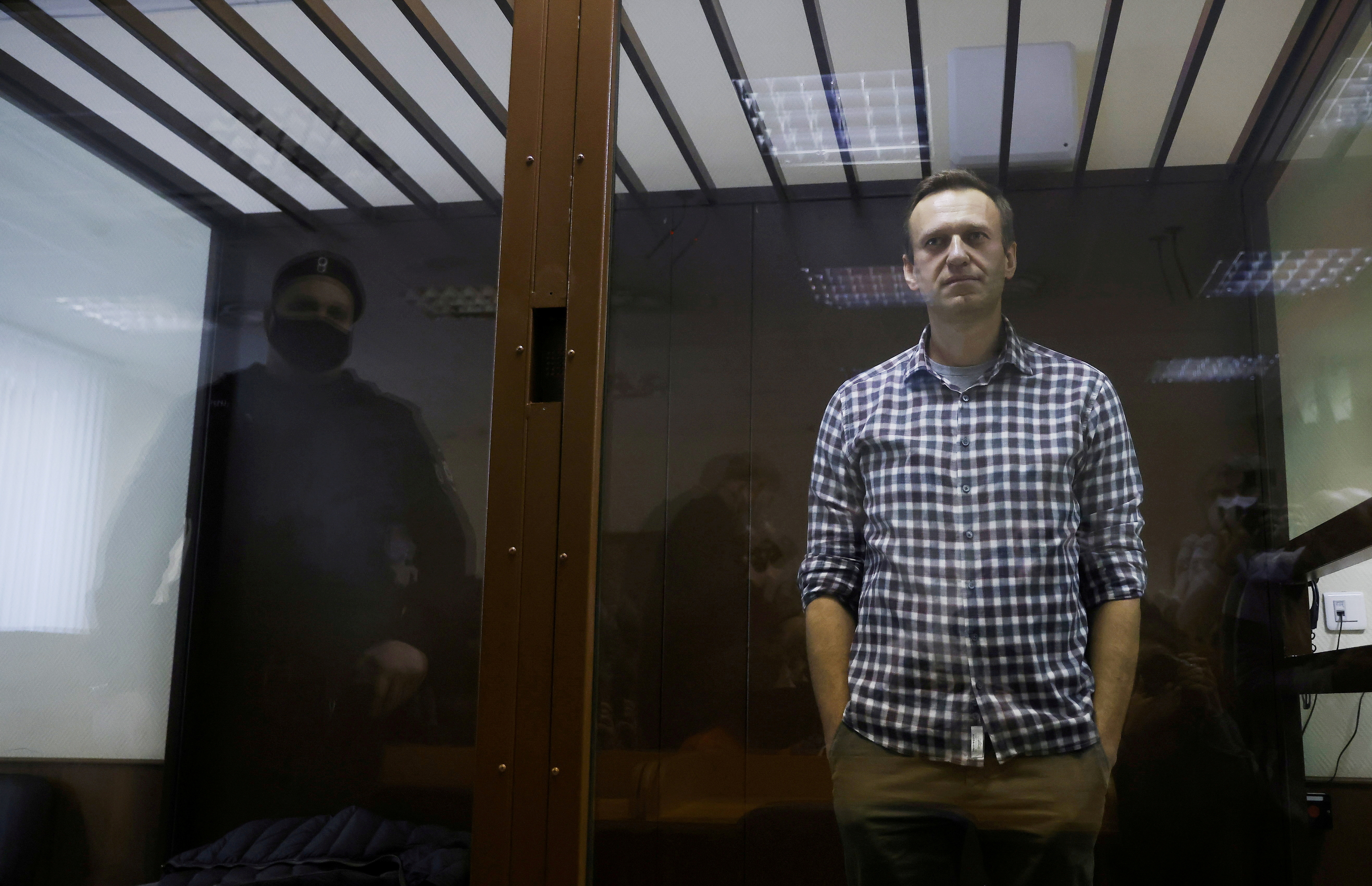 Russian opposition leader Alexei Navalny attends a hearing to consider an appeal against an earlier court decision to change his suspended sentence to a real prison term, in Moscow, Russia February 20, 2021. REUTERS/Maxim Shemetov
