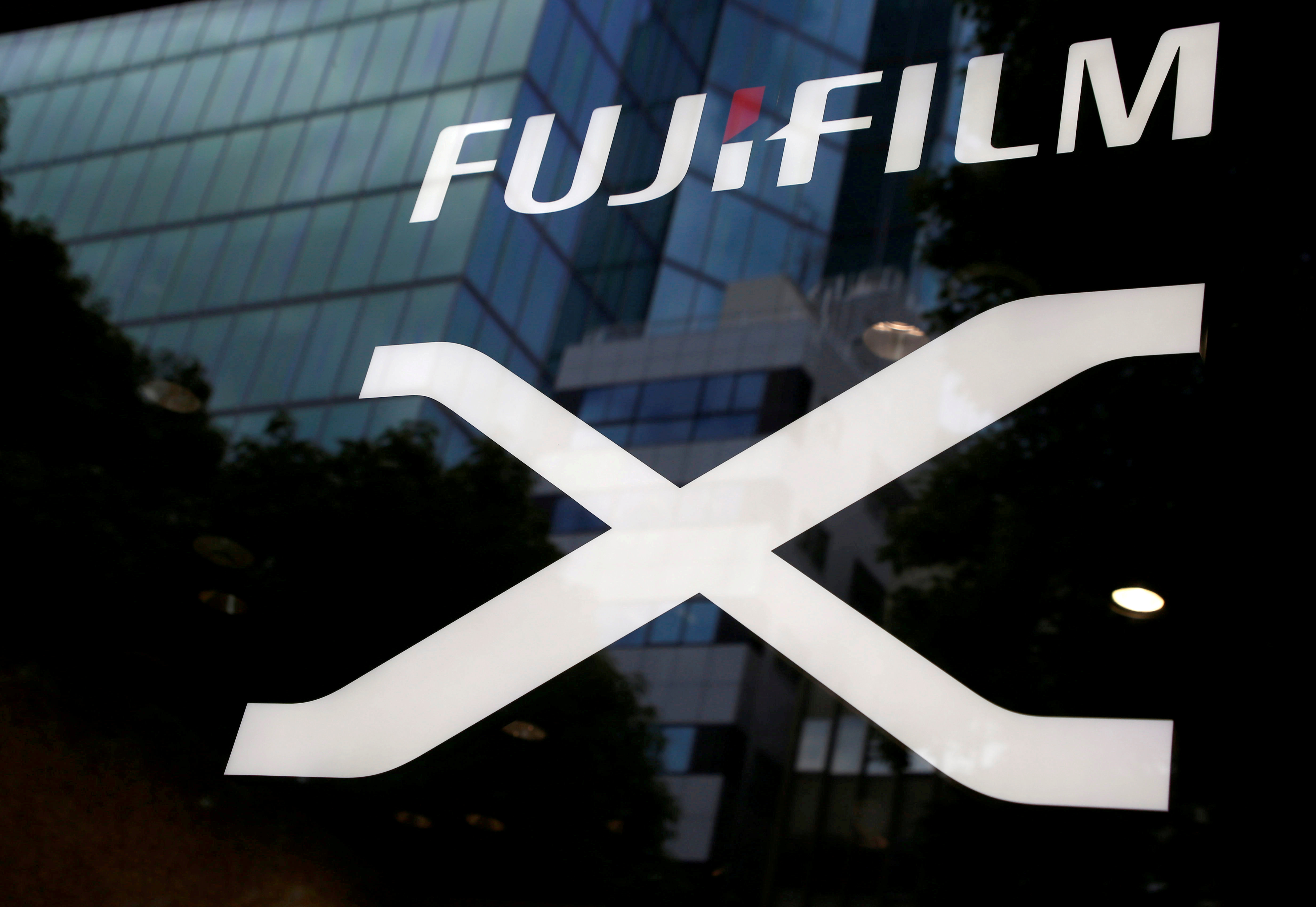 Fujifilm's company logo (top) is seen at its exhibition hall nearby the headquarters of Fujifilm Holdings Corp in Tokyo, Japan June 12, 2017. REUTERS/Kim Kyung-Hoon/File Photo