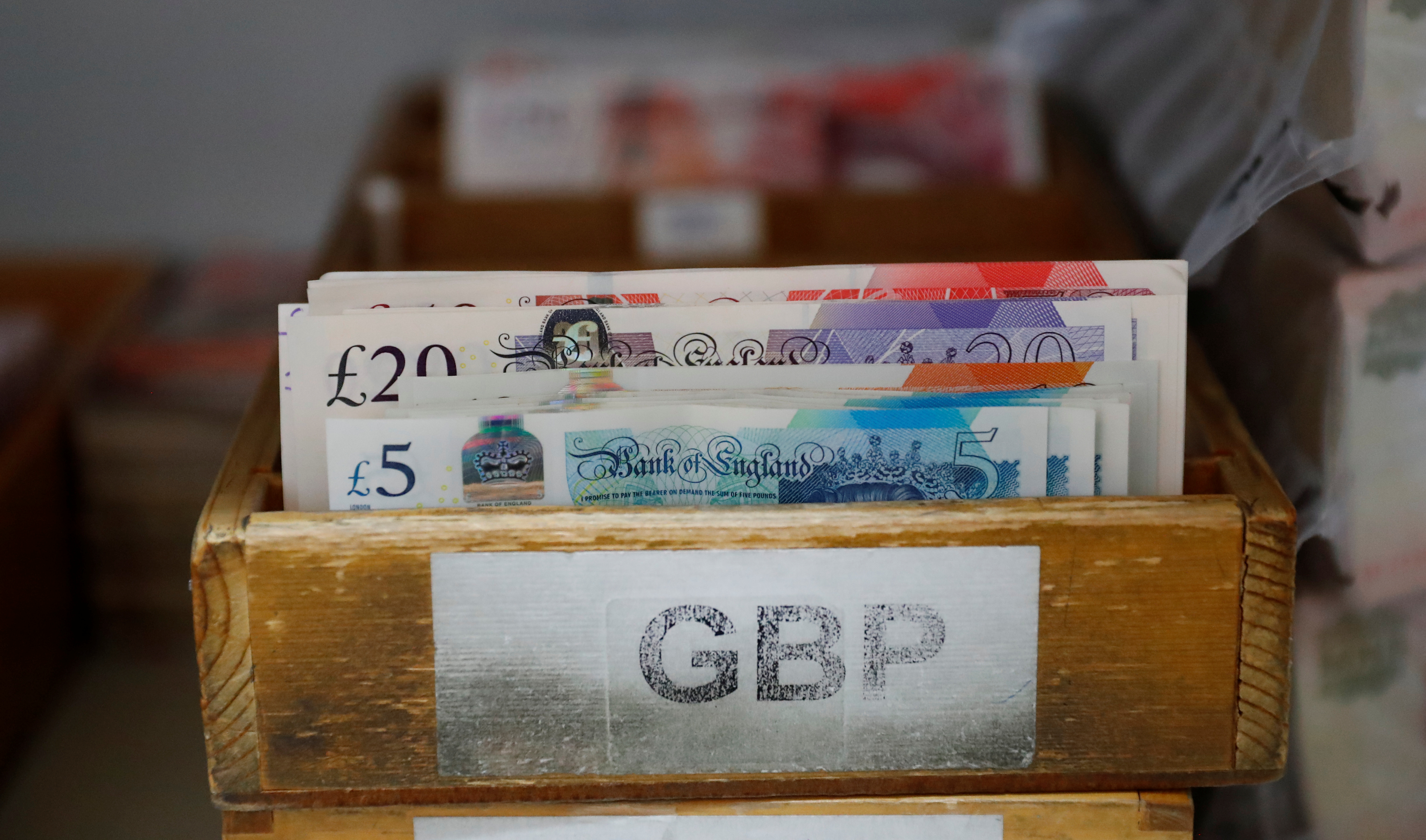 British Pound Sterling banknotes are seen in a box at the Money Service Austria company's headquarters in Vienna, Austria, November 16, 2017.REUTERS/Leonhard Foeger
