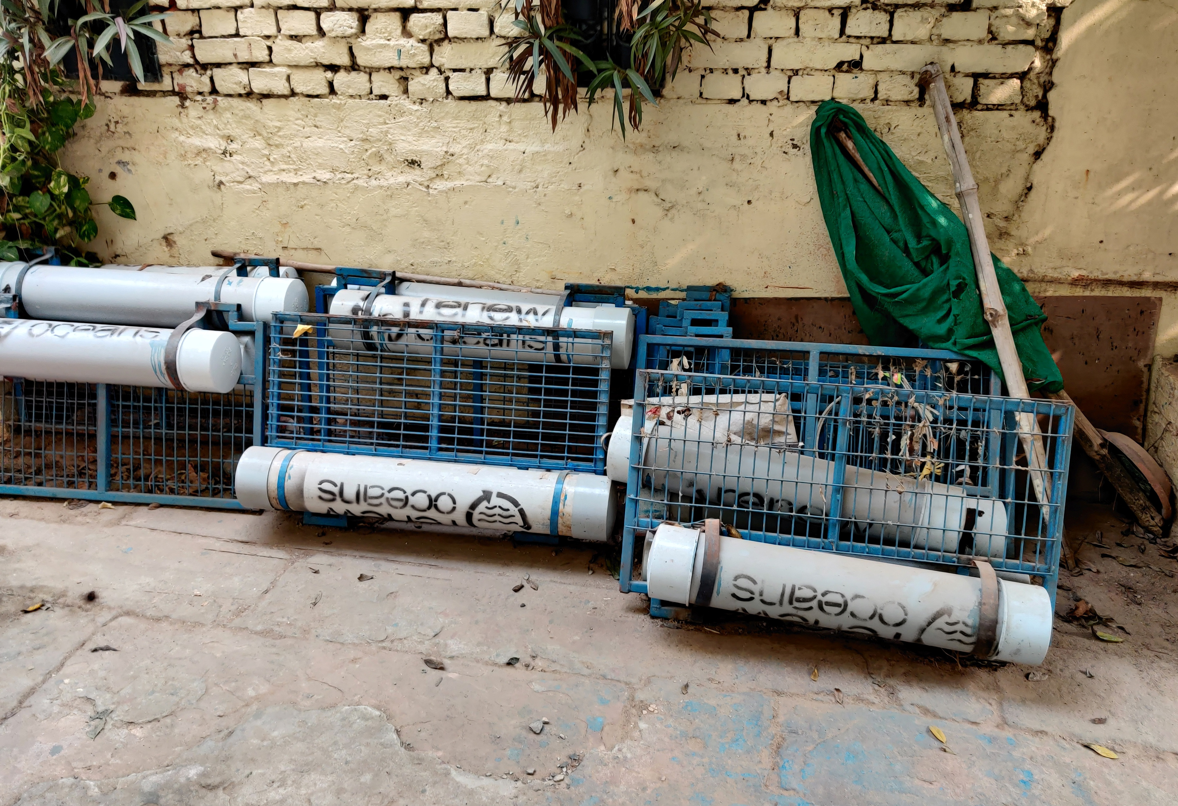 Litter traps are seen outside the locked office of Renew Oceans in Varanasi, in the northern state of Uttar Pradesh, India, December 4, 2020. REUTERS/Saurabh Sharma