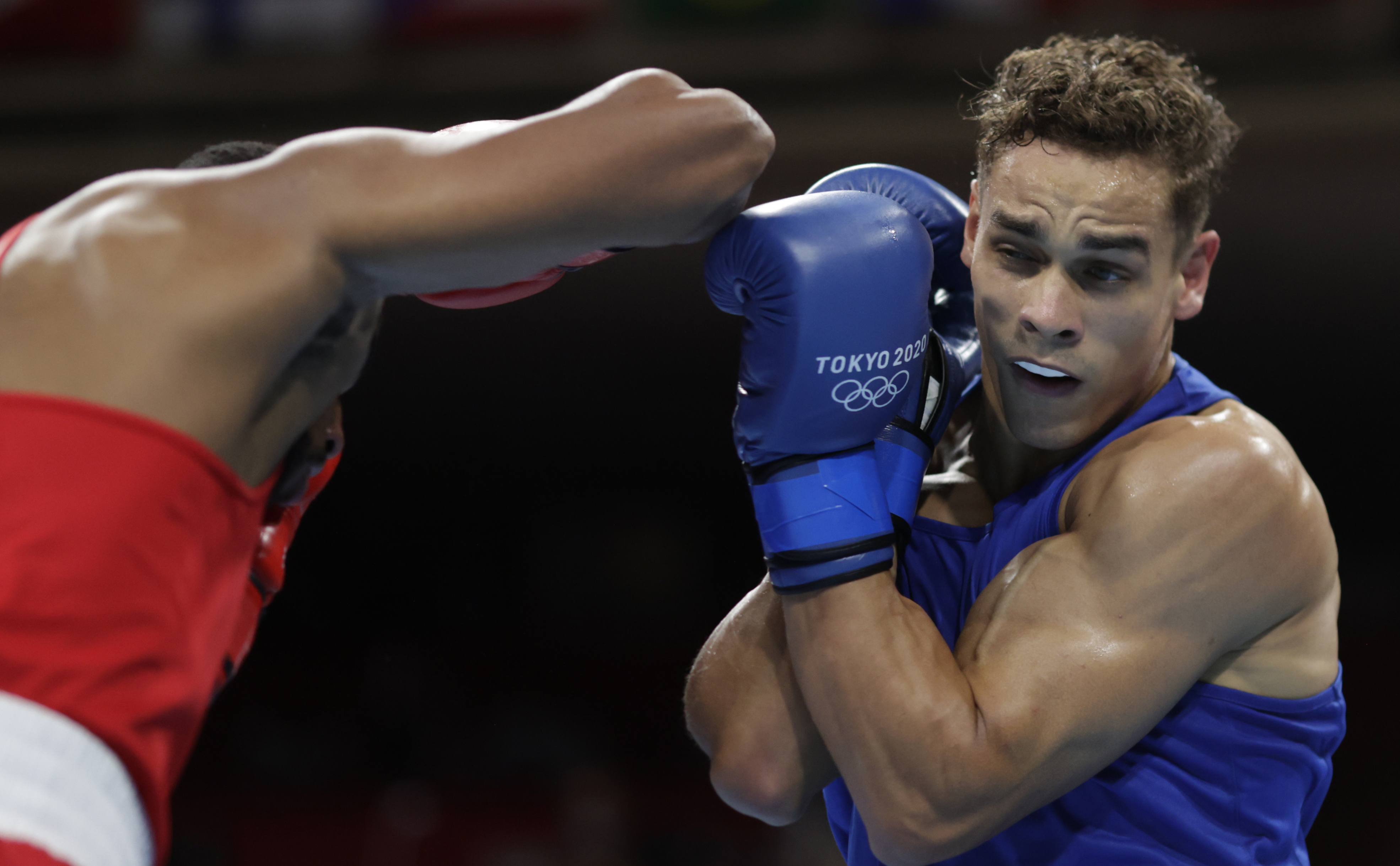 Tokyo 2020 Olympics - Boxing - Men's Heavyweight - Last 16 - Kokugikan Arena - Tokyo, Japan - July 27, 2021. Youness Baalla of Morocco in action against David Nyika of New Zealand REUTERS/Ueslei Marcelino