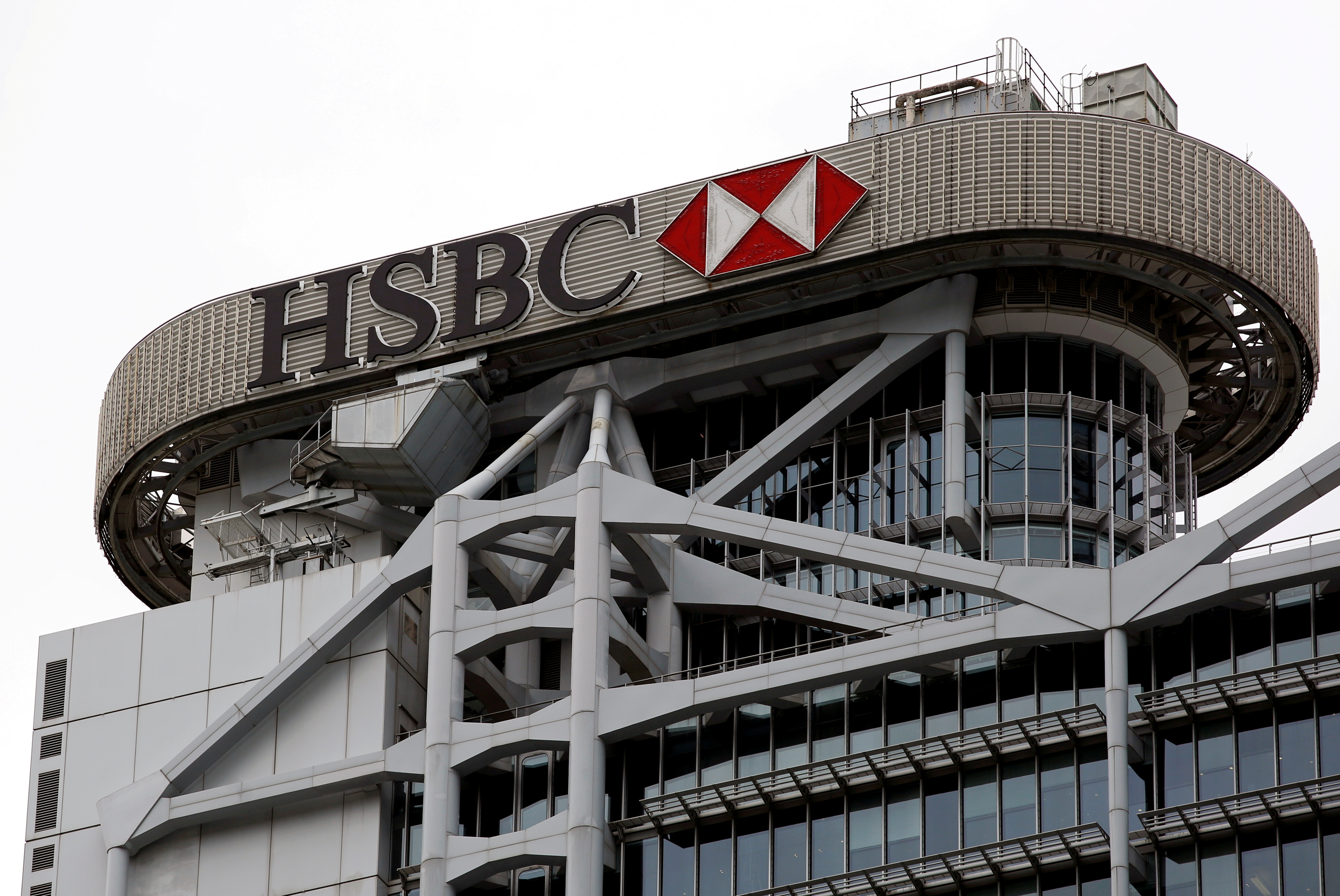 A logo of HSBC is seen on its headquarters at the financial Central district in Hong Kong, China August 4, 2020. REUTERS/Tyrone Siu
