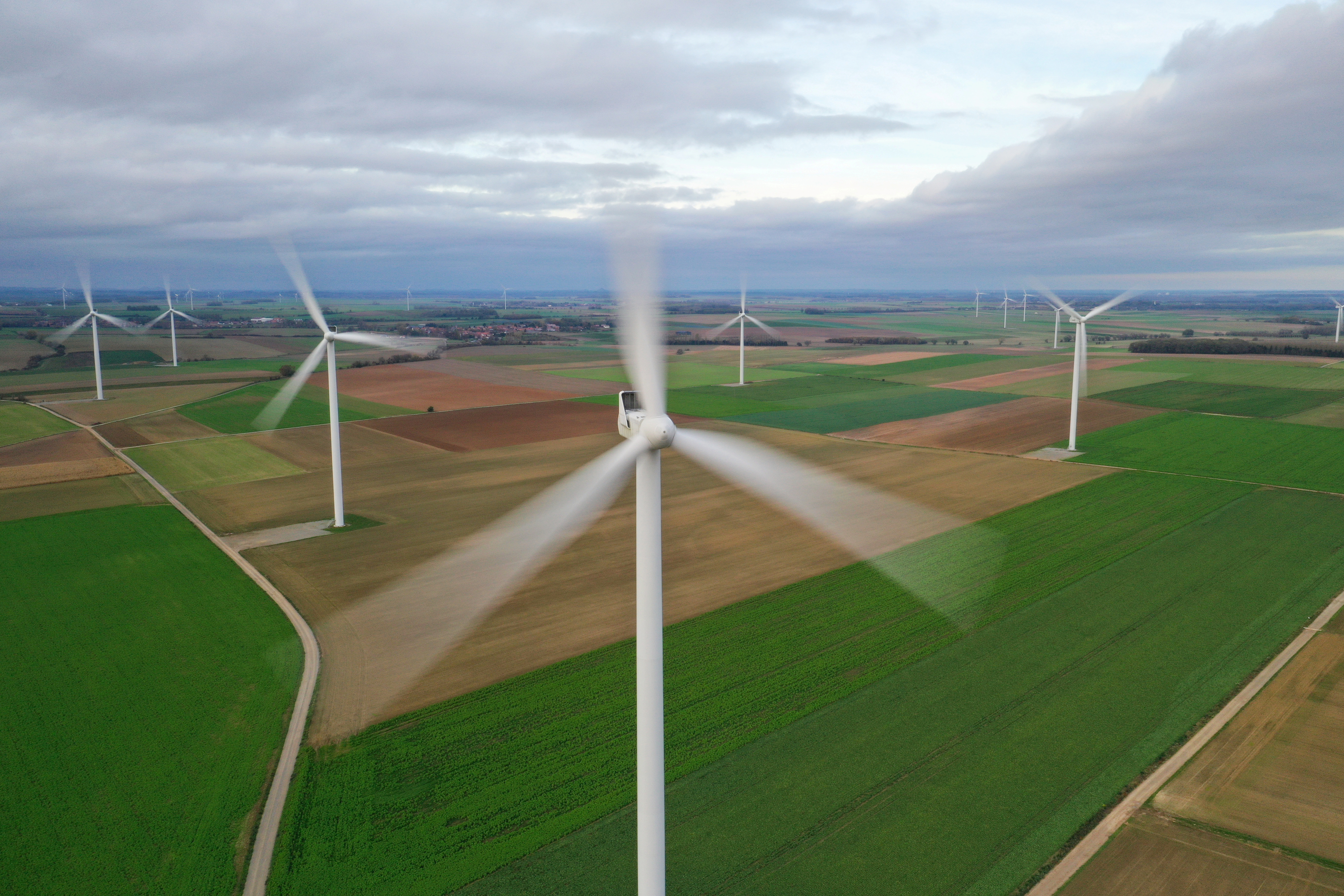 An aerial view shows power-generating windmill turbines in a wind farm in Morchies, France, November 8, 2020. Picture taken with a drone REUTERS/Pascal Rossignol/File Photo