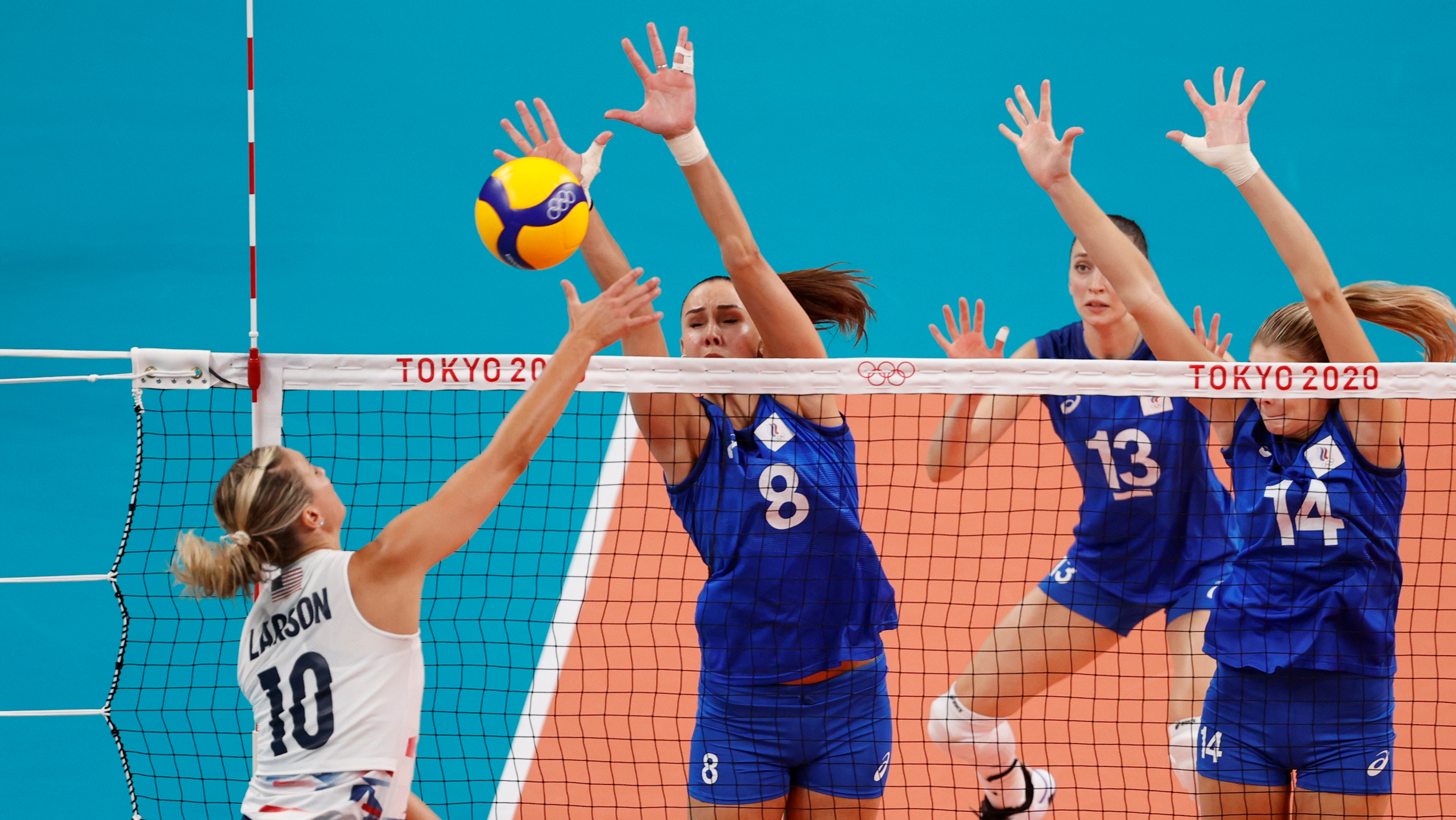 Tokyo 2020 Olympics - Volleyball - Women's Pool B - United States v The Russian Olympic Committee - Ariake Arena, Tokyo, Japan – July 31, 2021. Jordan Larson of the United States in action with Natalya Goncharova of the Russian Olympic Committee and Irina Fetisova of the Russian Olympic Committee. REUTERS/Valentyn Ogirenko