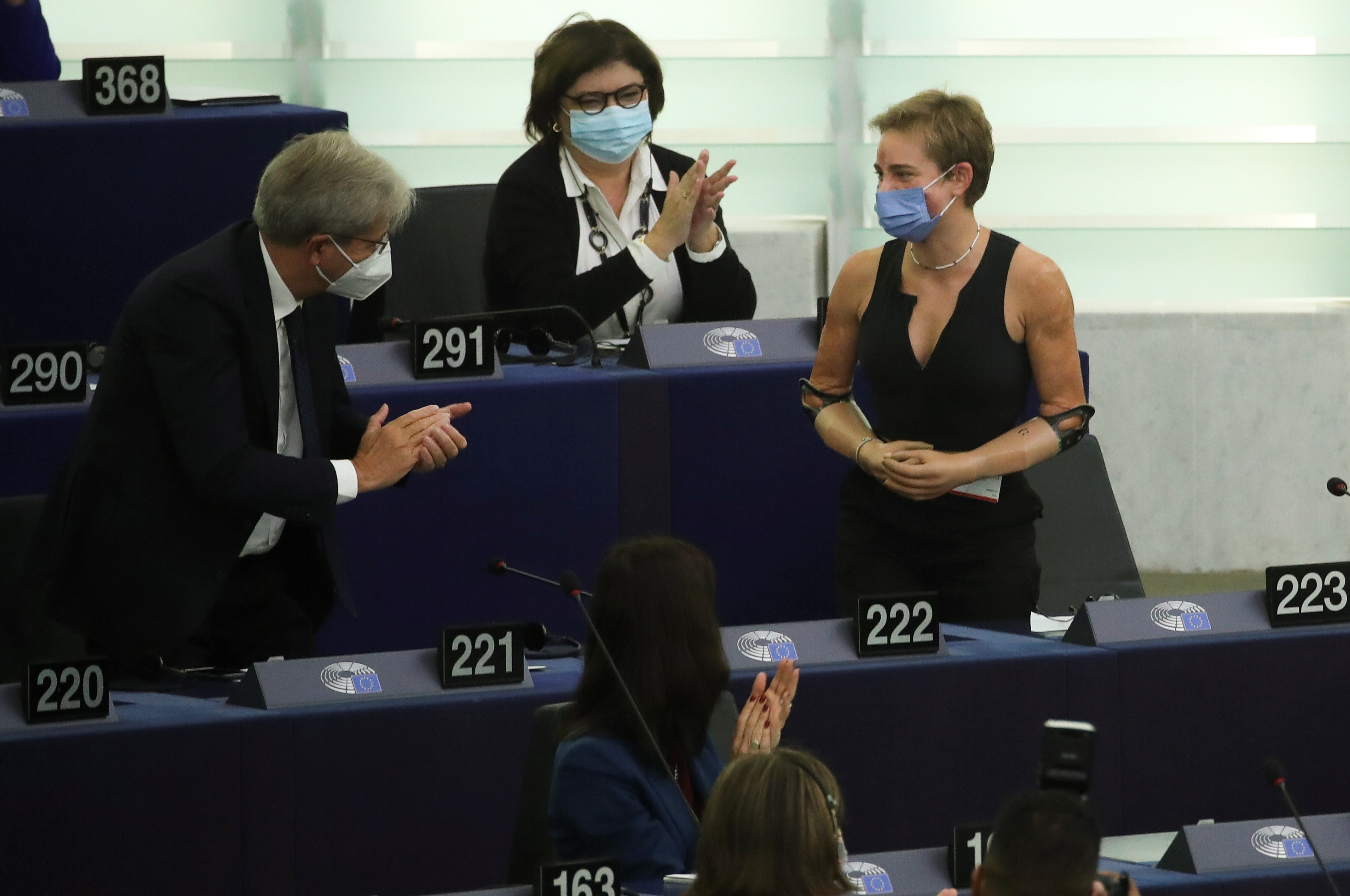 European Economy Commissioner Paolo Gentiloni and European Parliament members applaud Tokyo 2020 Paralympic gold medallist Beatrice Vio as European Commission President Ursula von der Leyen (not pictured) delivers a speech during a debate on