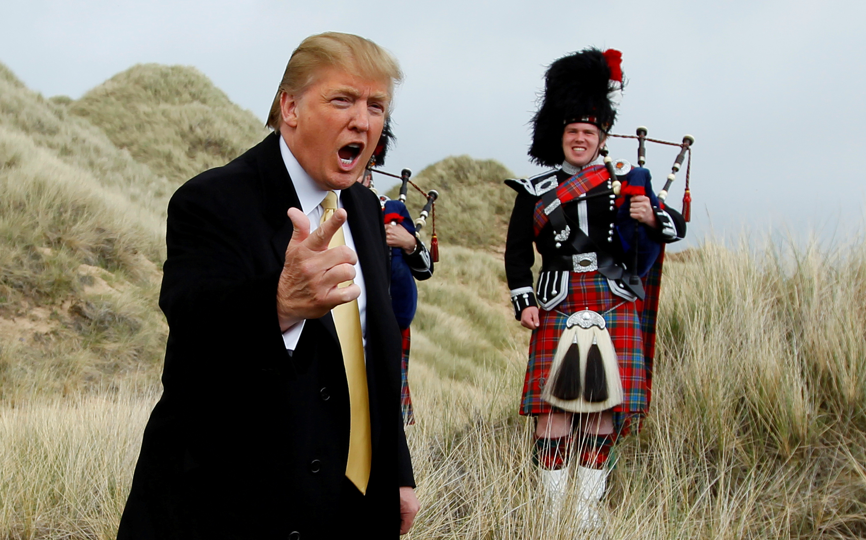 U.S. property mogul Donald Trump gestures during a media event on the sand dunes of the Menie estate, the site for Trump's proposed golf resort, near Aberdeen, north east Scotland May 27, 2010.  REUTERS/David Moir/File Photo/File Photo
