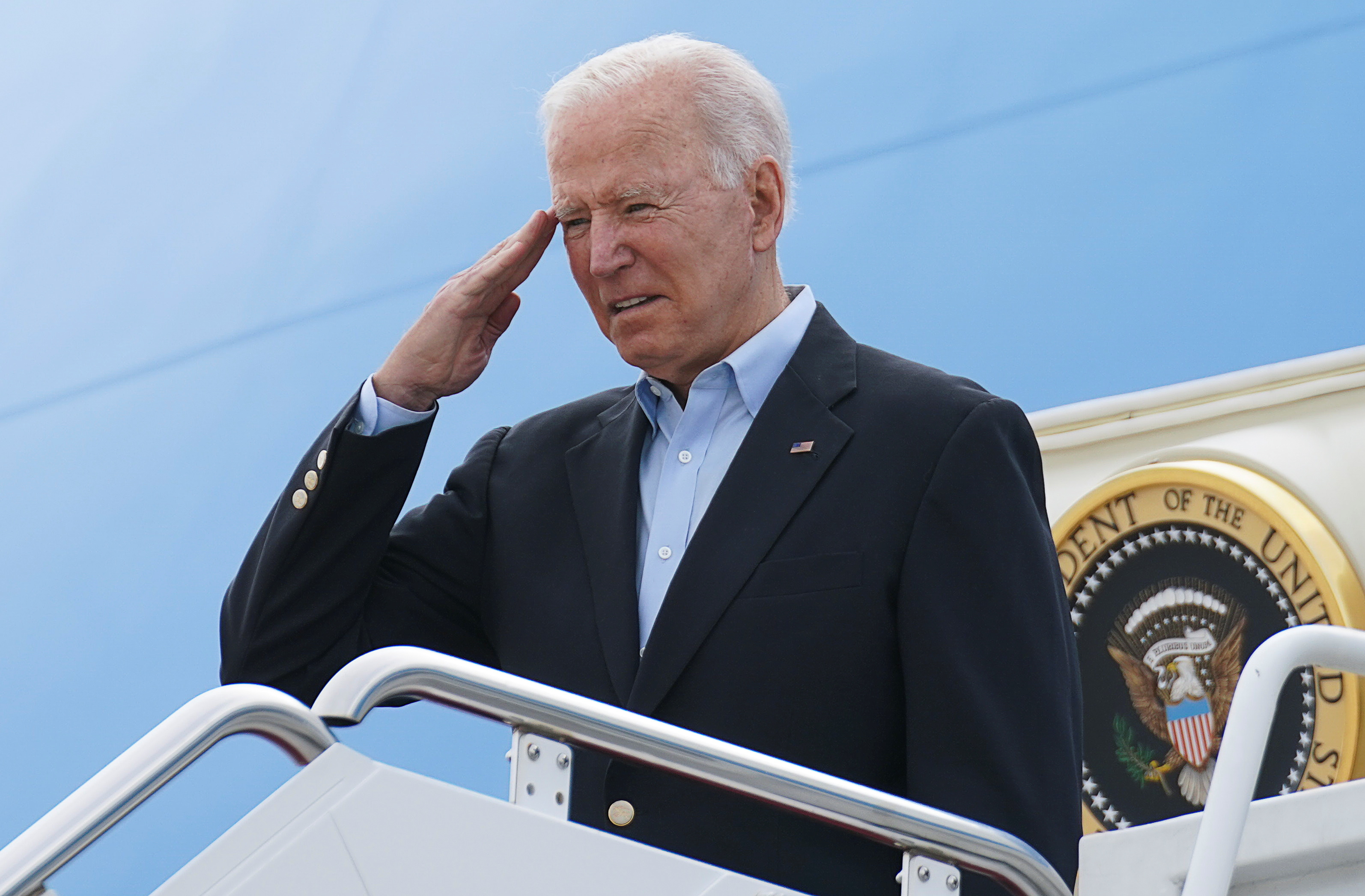 U.S. President Joe Biden salutes while boarding Air Force One as he departs on travel to attend the G-7 Summit in England, the first foreign trip of his presidency, from Joint Base Andrews, Maryland, U.S., June 9, 2021. REUTERS/Kevin Lamarque