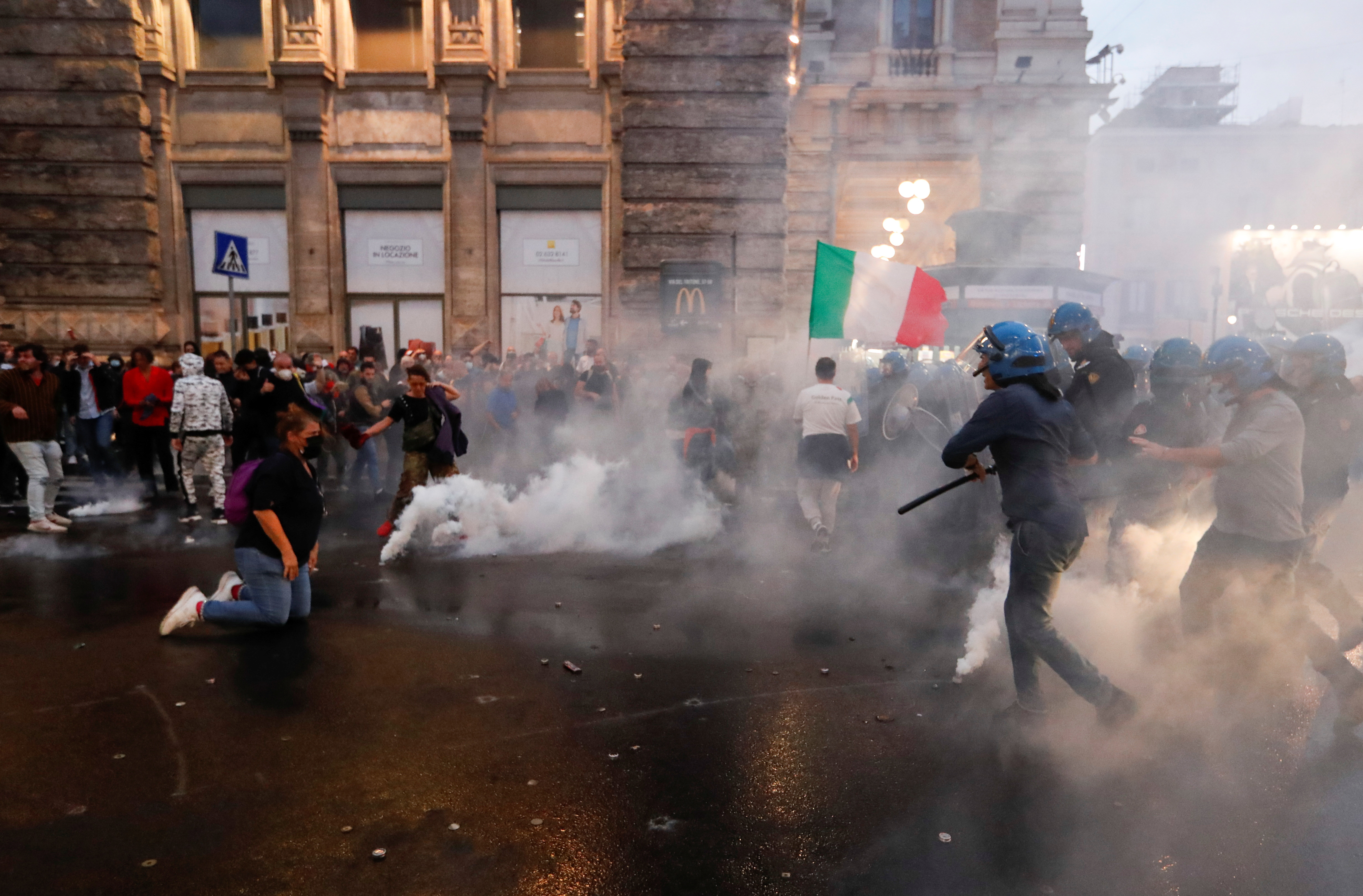 Demonstrators clash with police officers during a protest against the government's introduction of the
