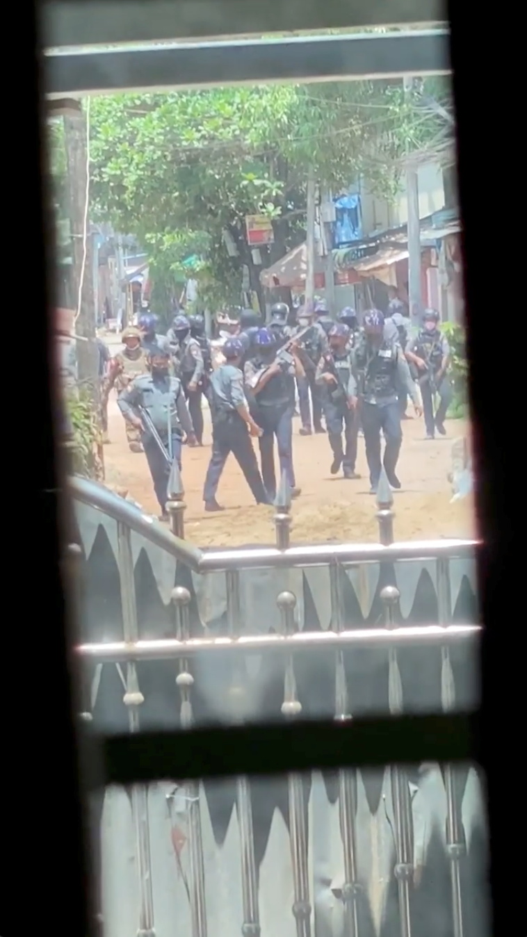 Security officers walk down the street during crackdown in Bago, Myanmar April 9, 2021 in this still image obtained by Reuters from a video.