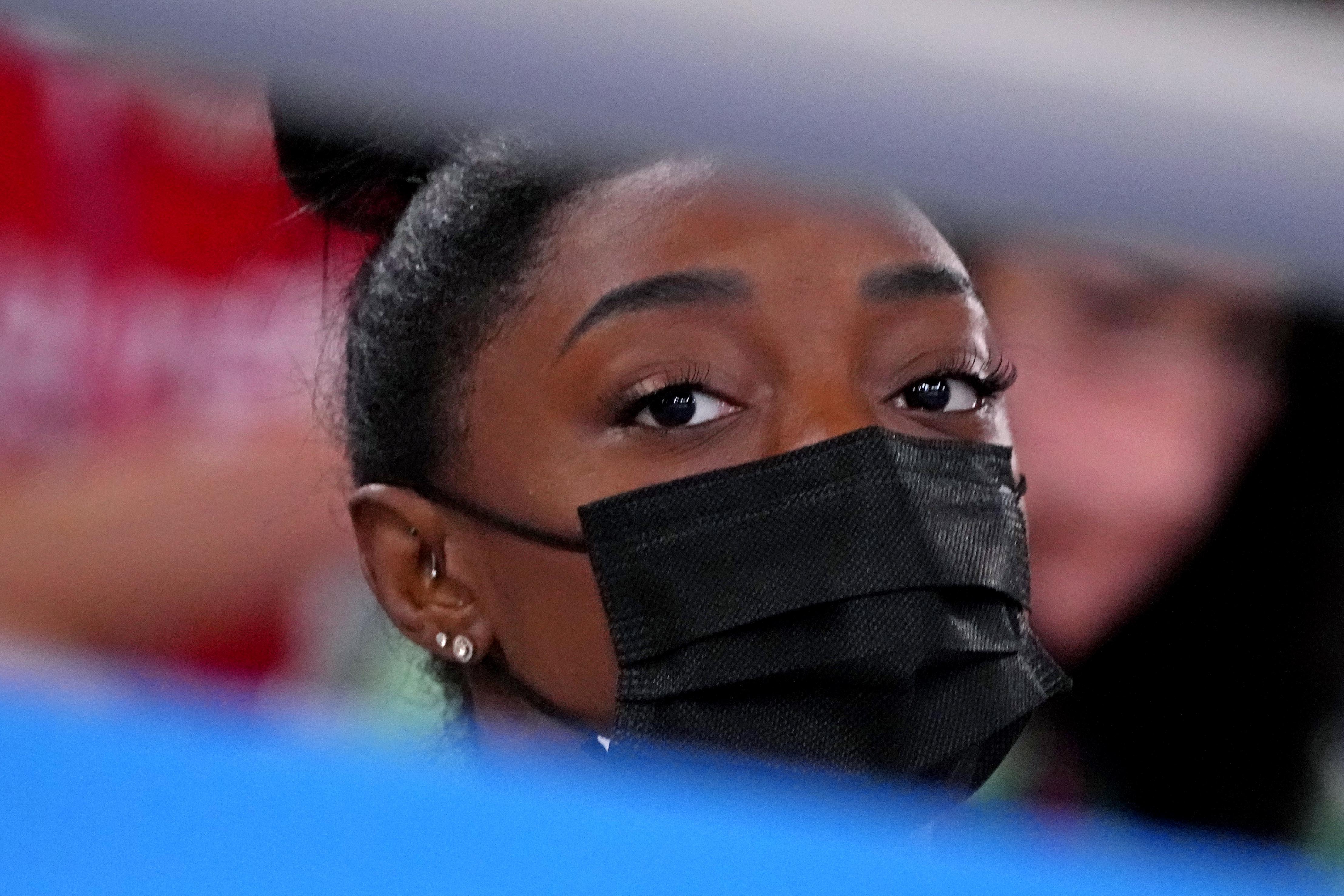 Jul 29, 2021; Tokyo, Japan; Simone Biles looks on in the women's gymnastics individual all-around final during the Tokyo 2020 Olympic Summer Games at Ariake Gymnastics Centre. Mandatory Credit: Robert Deutsch-USA TODAY Sports