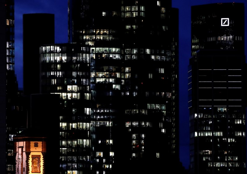 Offices and residential buildings are illuminated as the spread of the coronavirus disease (COVID-19) continues during an extended lockdown and a demand by the German government for more home office possibilities in Frankfurt, Germany, January 28, 2021.  REUTERS/Kai Pfaffenbach