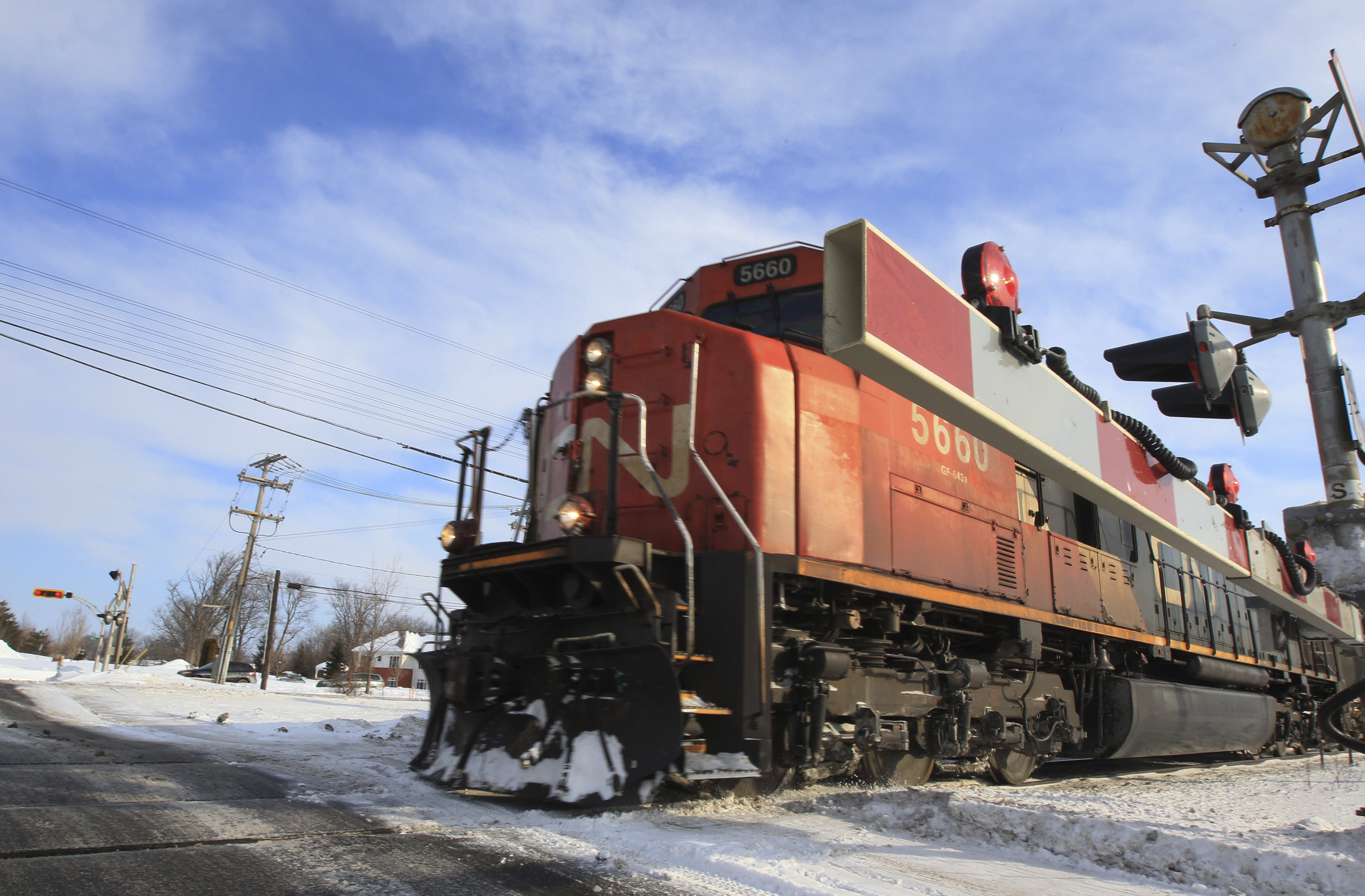 A Canadian National Railway train travels westward on a track in Montreal, February 15, 2015. REUTERS/Christinne Muschi