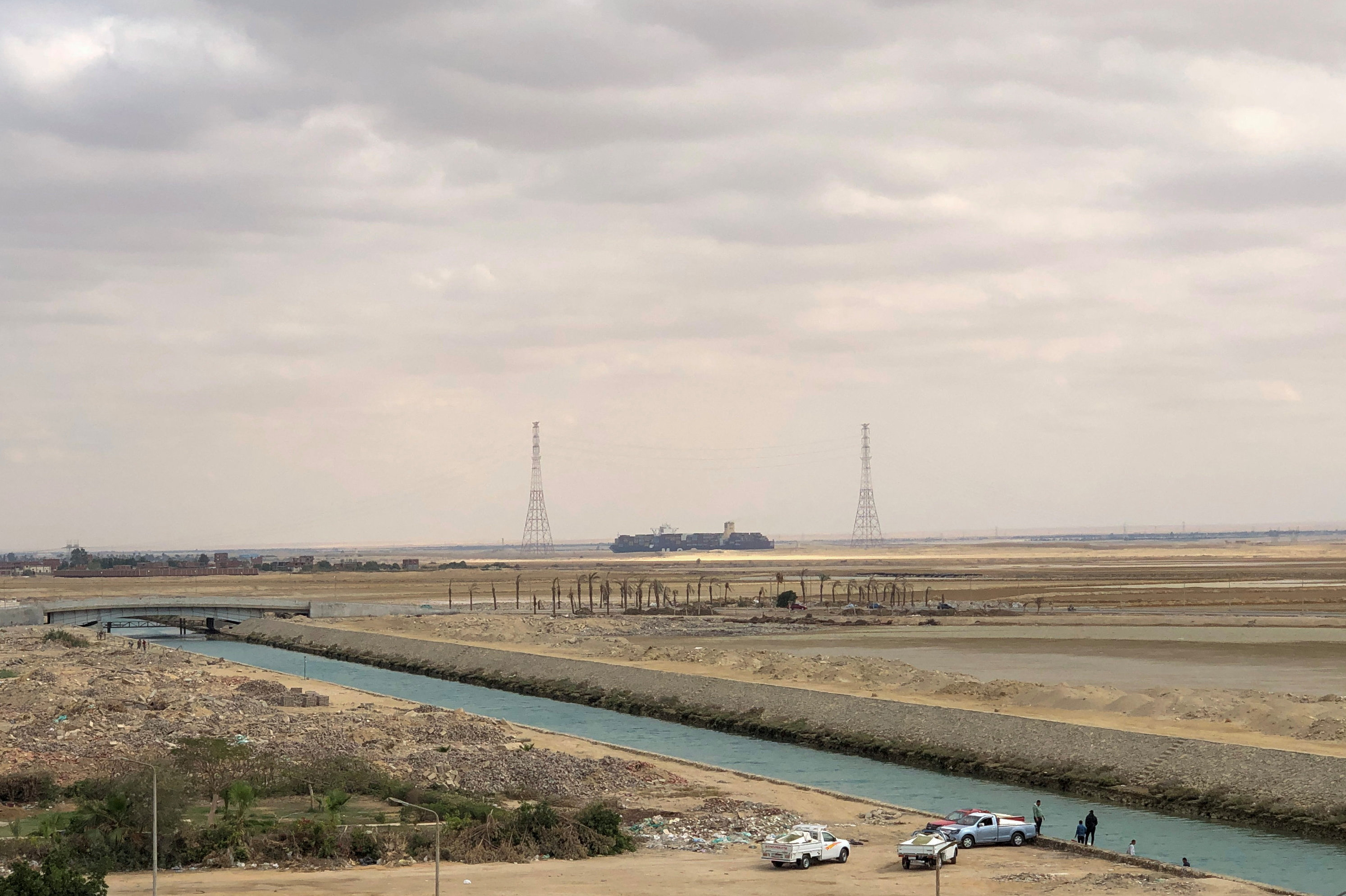 A ship sails through Suez Canal as traffic resumes after a container ship that blocked the waterway was refloated, Egypt, March 30, 2021. REUTERS/Ahmed Fahmy