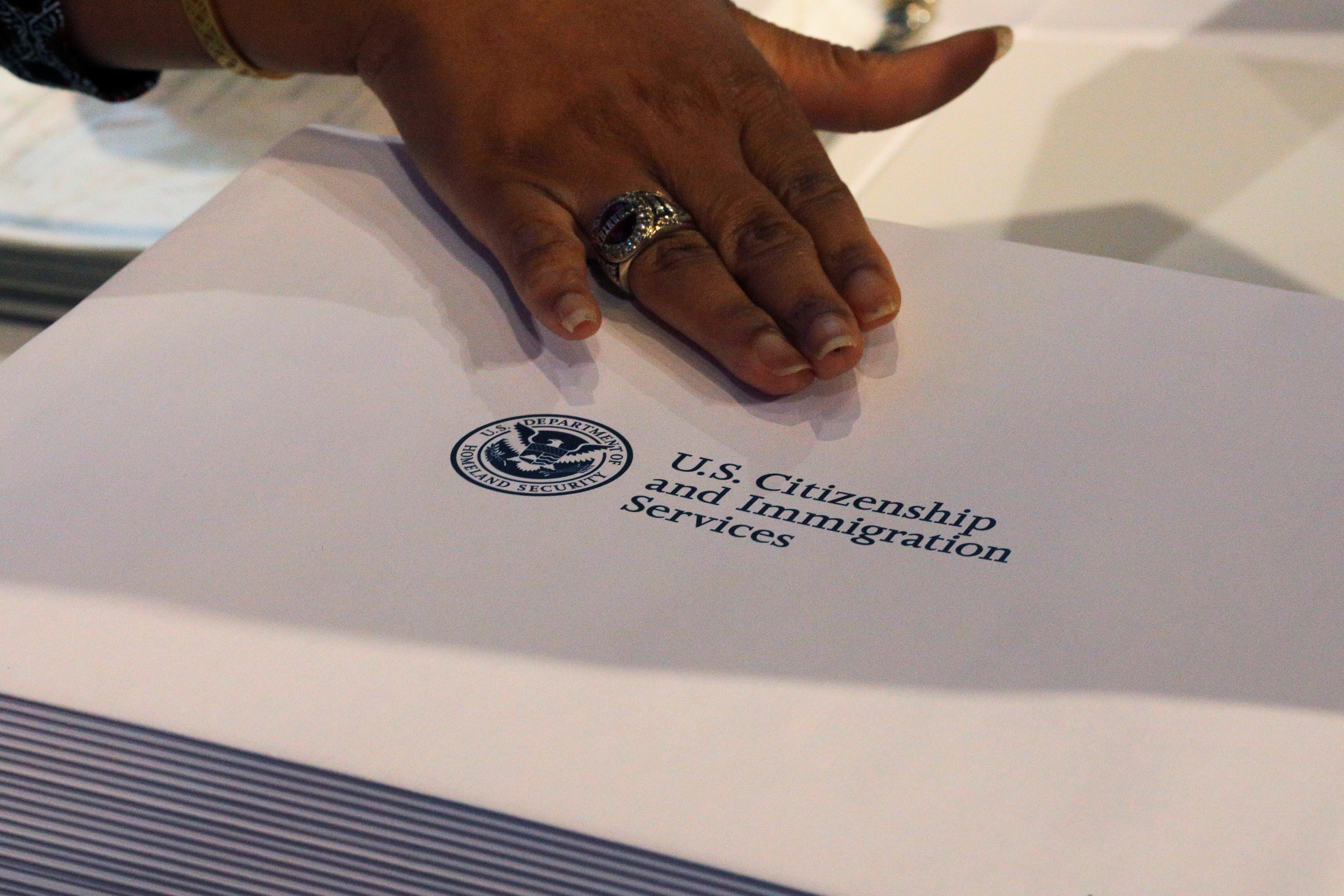 Information packs are distributed by the U.S. Citizenship and Immigration Services following a citizenship ceremony at the John F. Kennedy Presidential Library in Boston, Massachusetts, U.S., July 18, 2018.   REUTERS/Brian Snyder