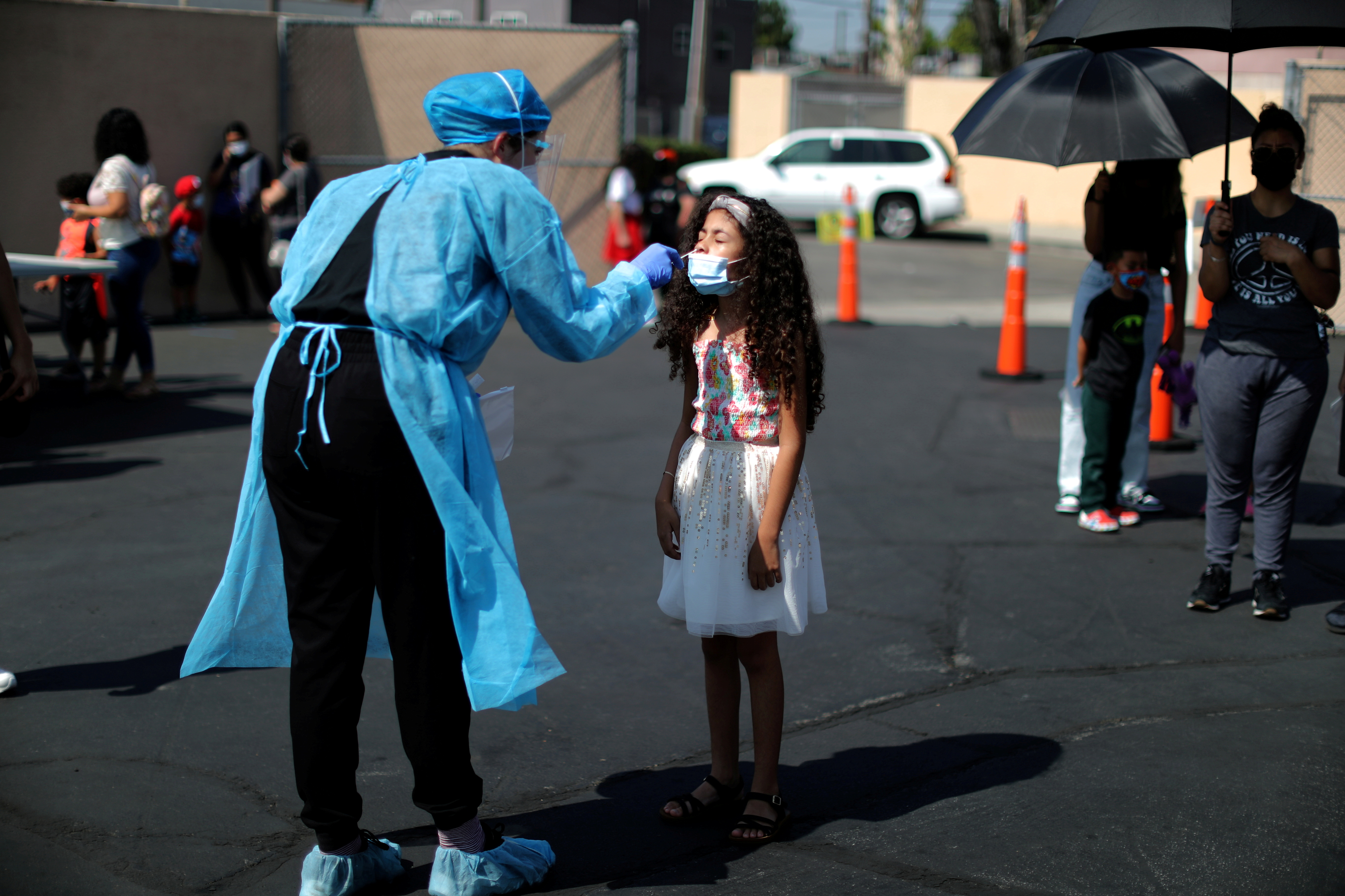Alisson Argueta, 8, is given a coronavirus disease (COVID-19) test at a back-to-school clinic in South Gate, Los Angeles, California, U.S., August 12, 2021. REUTERS/Lucy Nicholson/File Photo